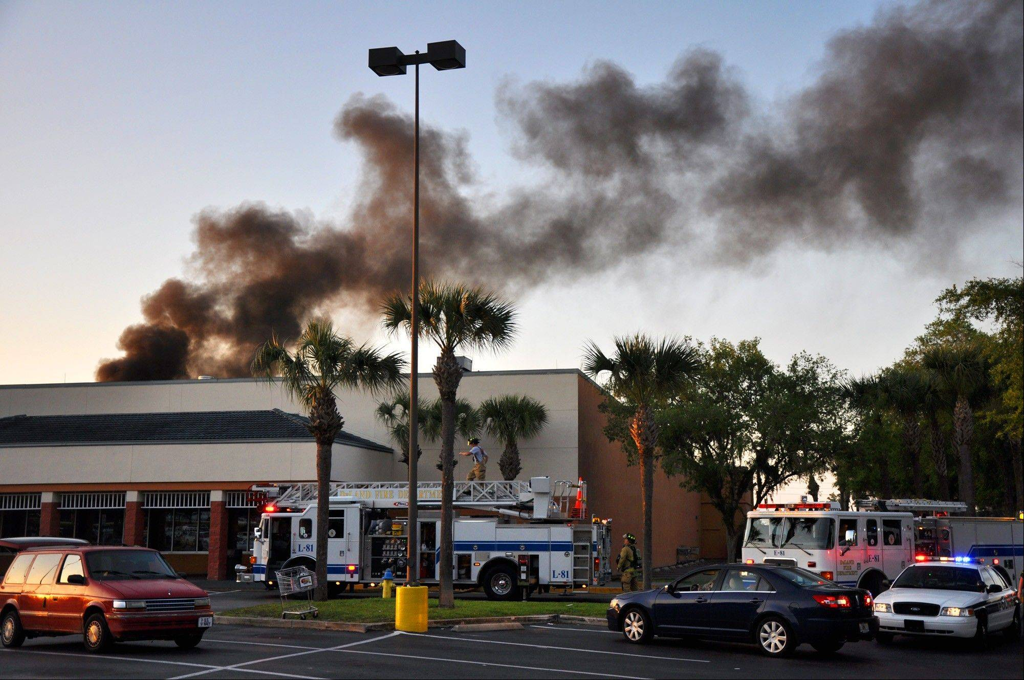 First responders from DeLand Fire Department, Volusia County Fire Services, EVAC and DeLand Police Department work the scene of a small plane crash at the Publix Supermarket on East International Speedway Boulevard, in DeLand, Fla., on April 2, 2012. The small plane sputtered and crashed in flames into the Florida shopping center, injuring at least five people as frightened shoppers rushed from the building, authorities and reports said.