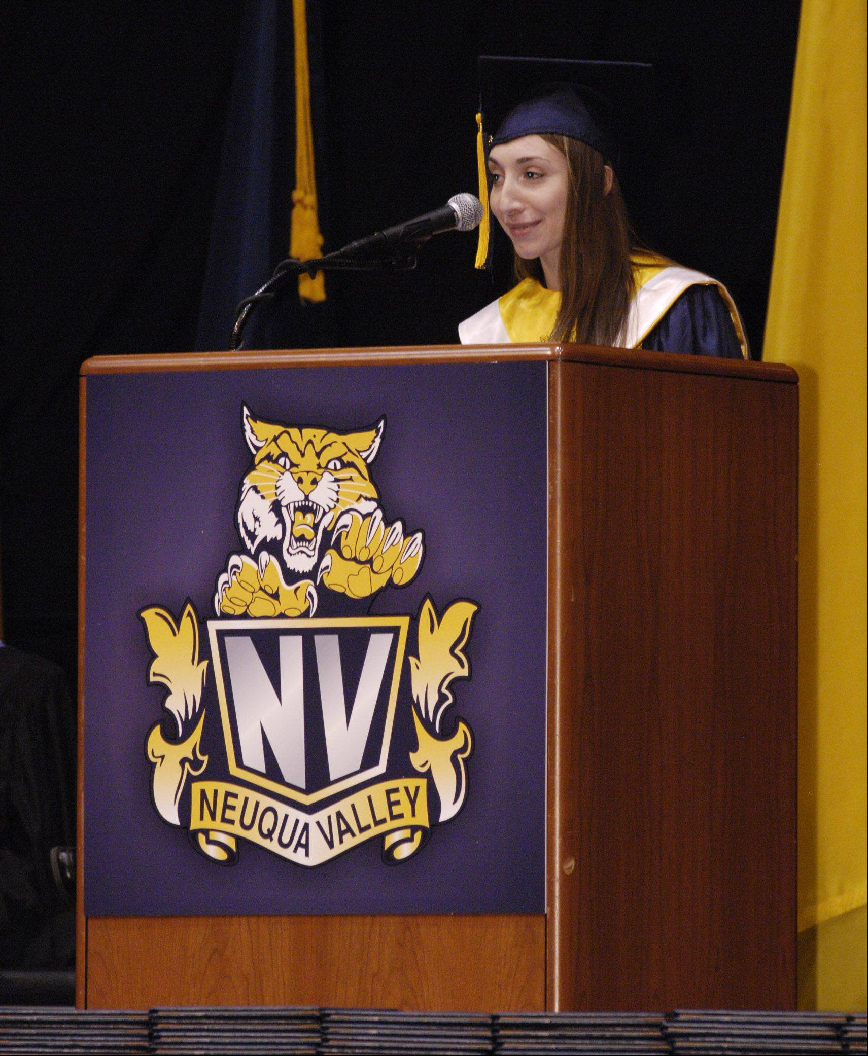 Julia Rabin gives the farewell address at Neuqua Valley High School's graduation ceremony Sunday at the NIU Convocation Center in DeKalb.