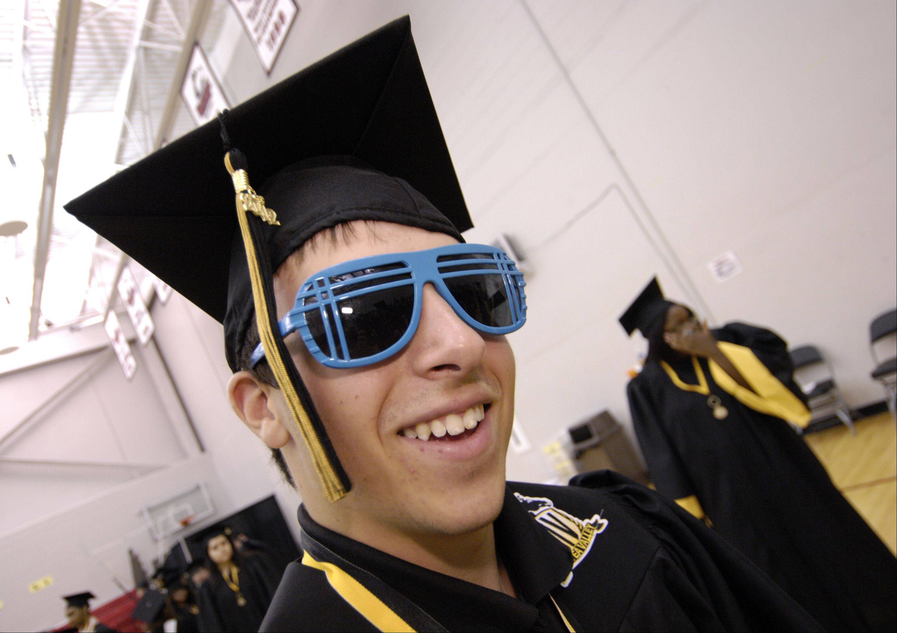 Kyle Luken sports some blue sunglasses as he lines up for the start of the inaugural Metea Valley High School graduation Sunday in DeKalb at the NIU Convocation Center.