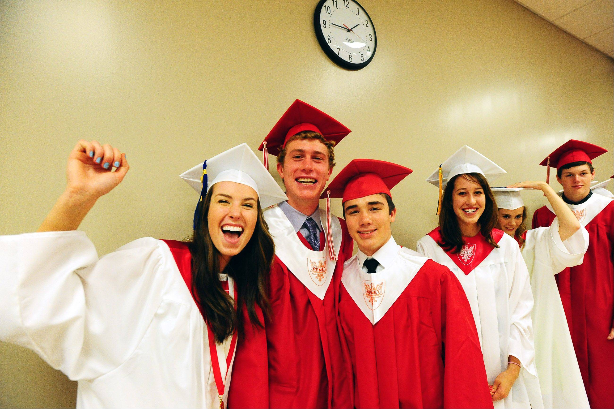 Madeline Carney, Thomas Chapman and Alex Gallicho celebrate before Sunday's graduation ceremony at Benet Academy in Lisle.