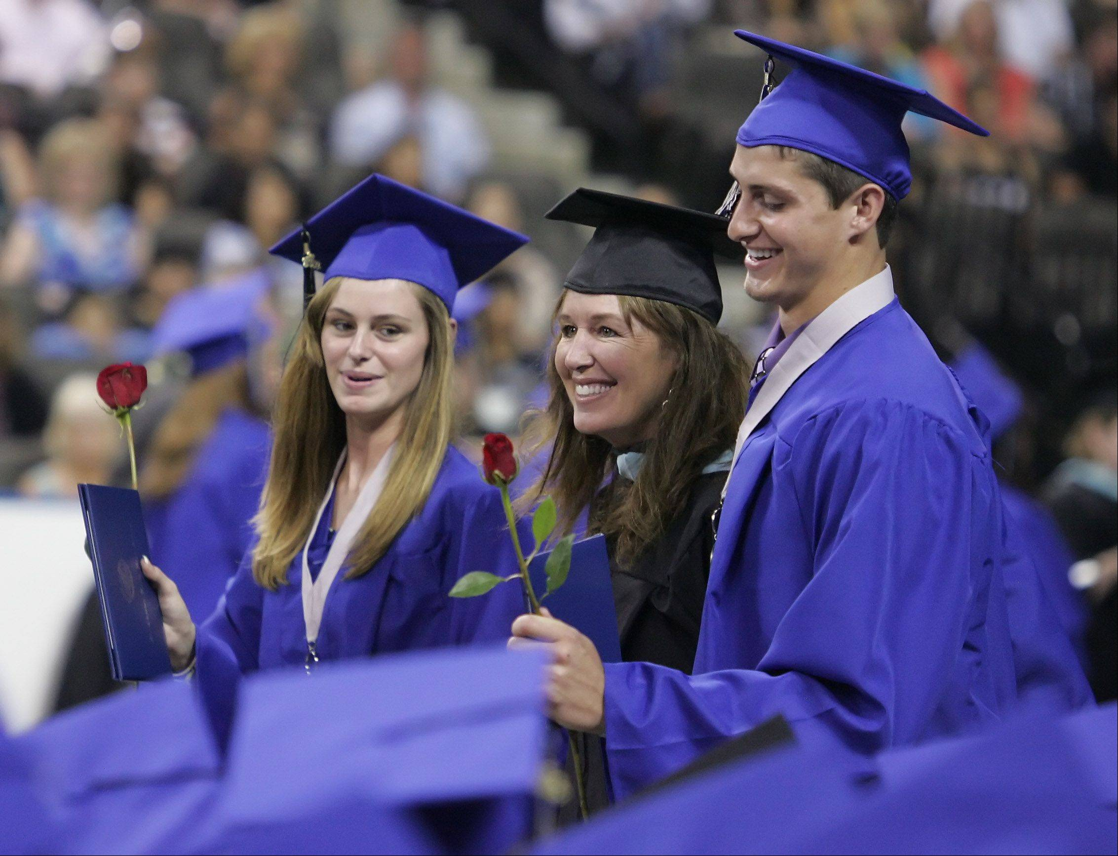 St. Charles North teacher Lori Creasor walks with her children, Sarah and Garrett, after they received their diplomas during the 2012 graduation ceremony for St. Charles North High School Sunday at the Sears Centre in Hoffman Estates. There were 508 seniors that graduated this year.