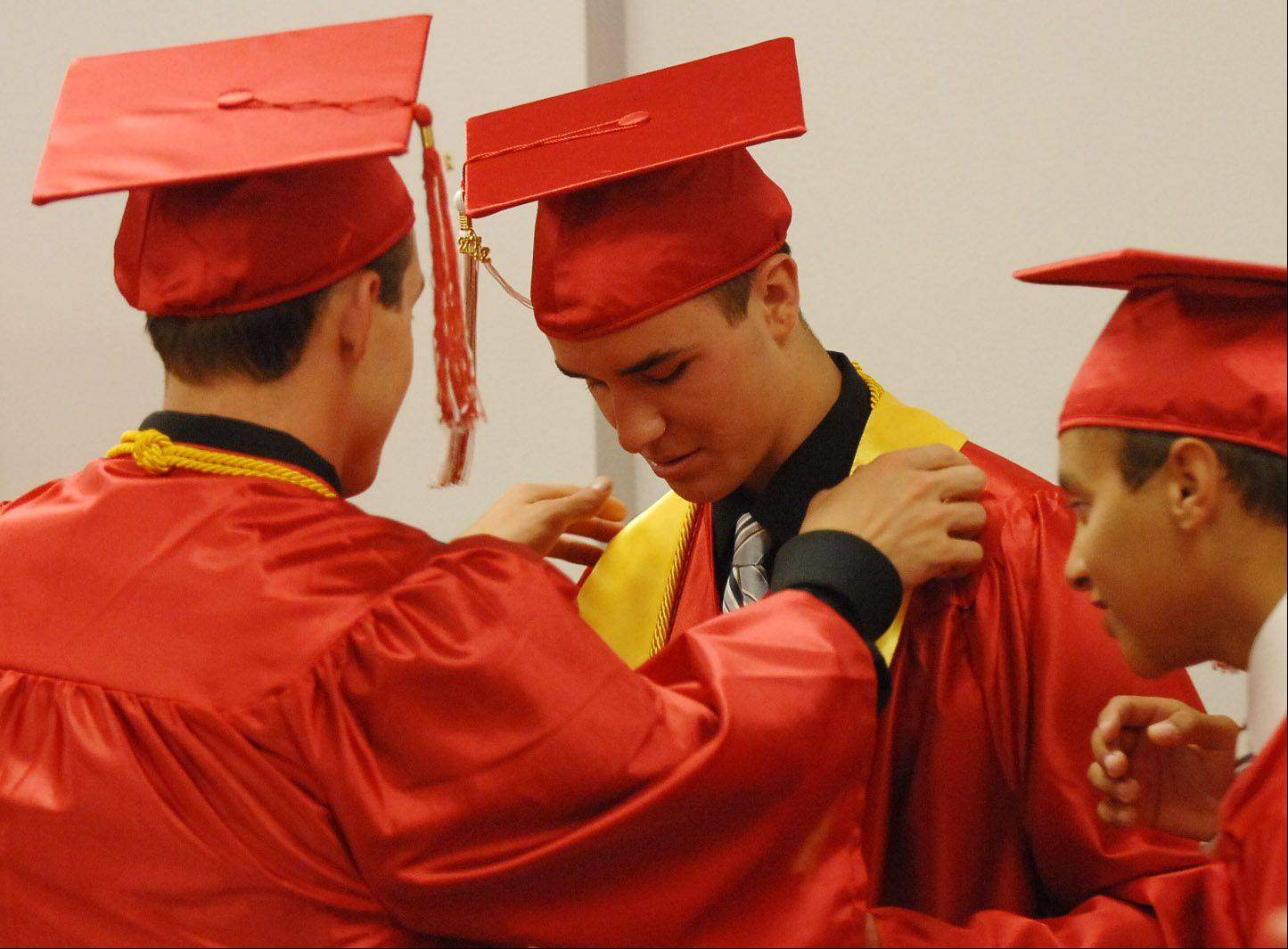 Valedictorian Jack Davis gets ready before the Aurora Christian School Class of 2012 Commencement on Sunday.