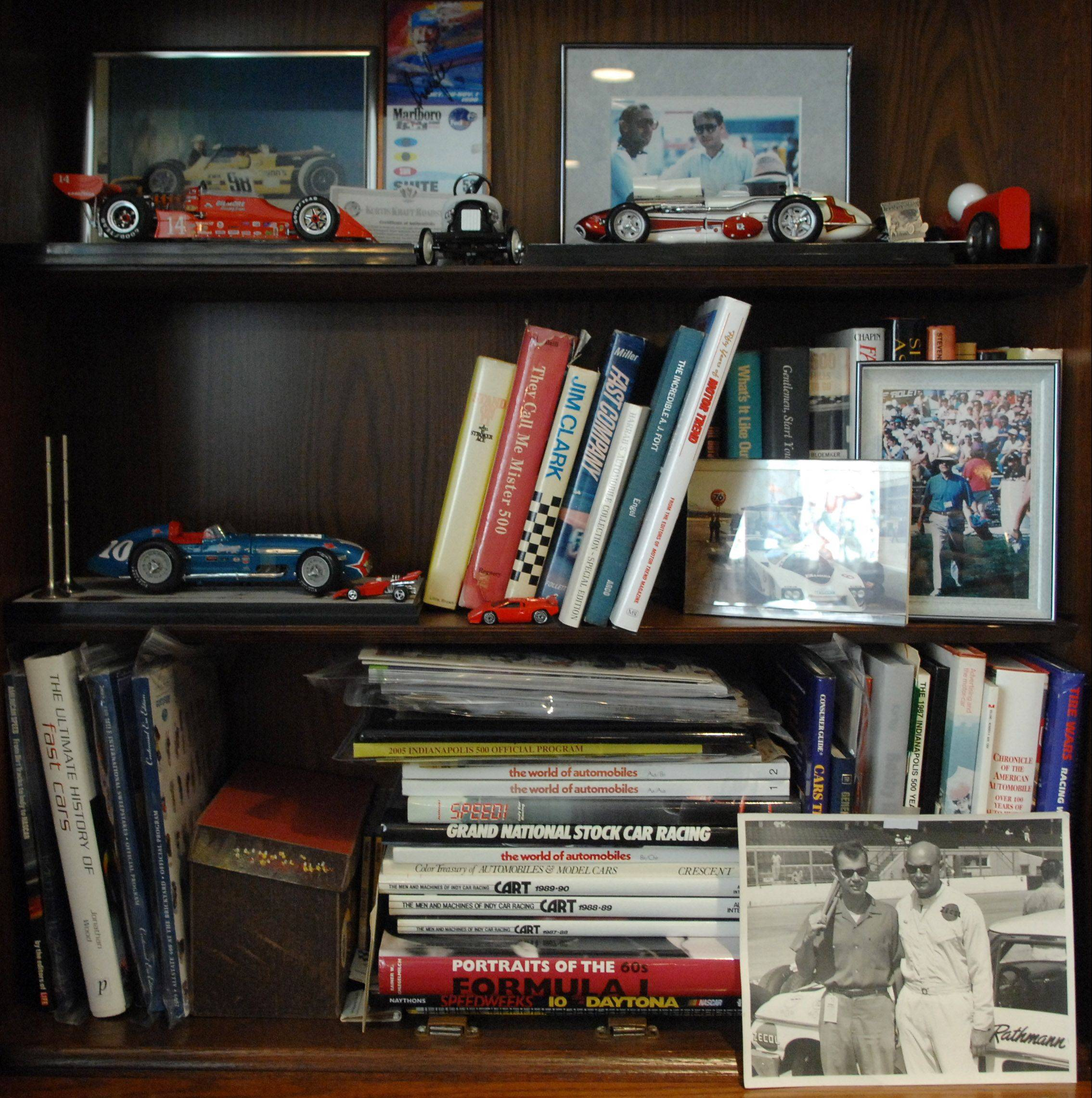Marshall Schneider, 82, of West Dundee shows a small sample of the collection of memorabilia he's amassed in the years since attending his first Indianapolis 500 in 1949 as a teenager who loved cars.