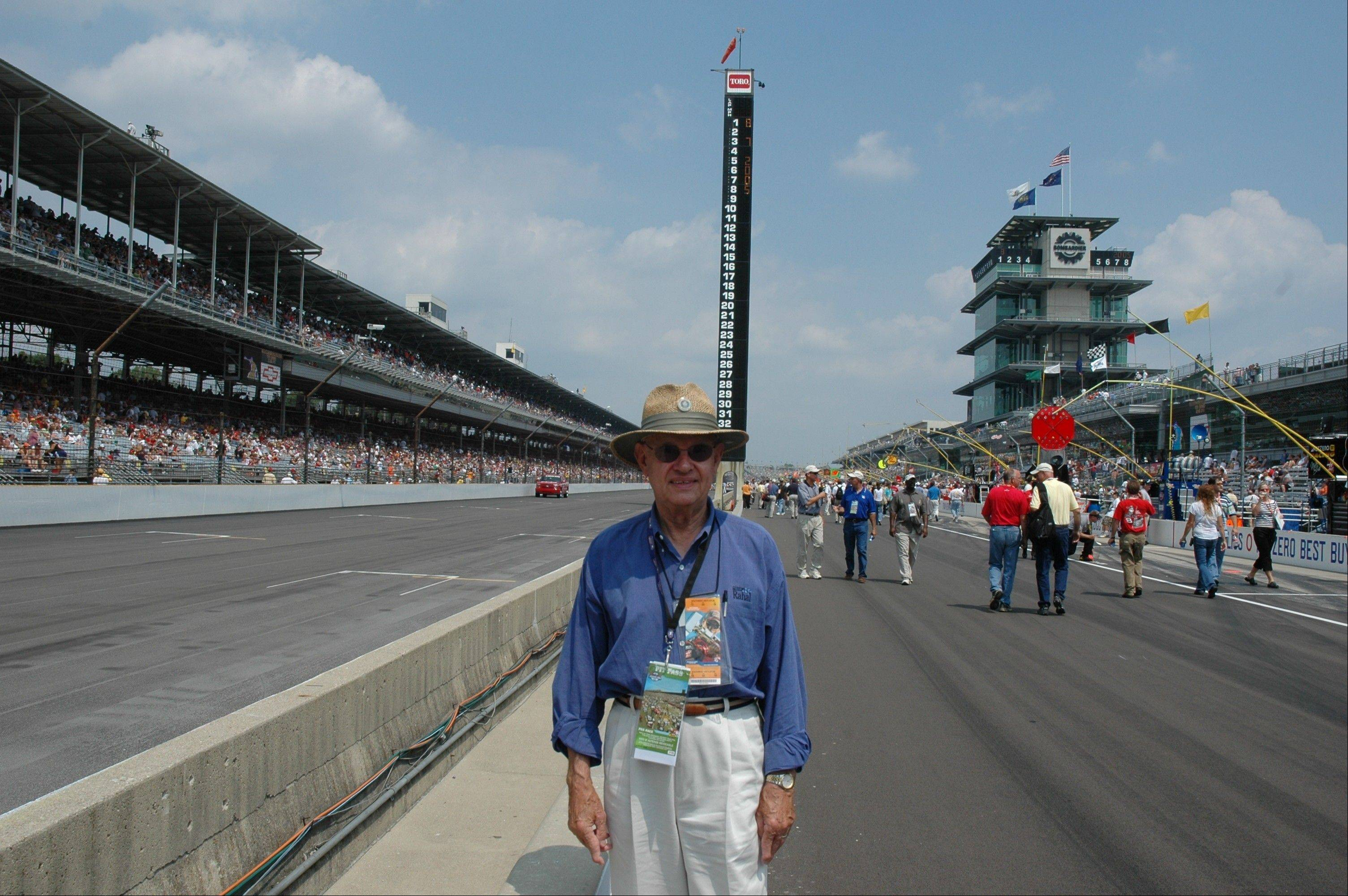 Standing in a pit lane next to the main straightaway, 82-year-old Marshall Schneider of West Dundee feels at home at the Indianapolis Motor Speedway. He went to his first Indy 500 race as an Elgin teen in 1949, when the winning speed was 121 mph. He plans to be at today's race with sons, Jerry and Ron, who have accompanied their dad to almost every Indy 500 for most of the past four decades.