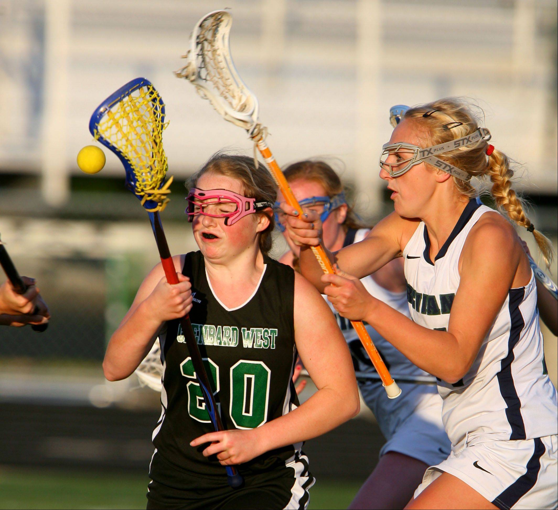 Glenbard West's Katy Ludington, left, and New Trier's Katy Weeks battle during sectional action at Fremd.
