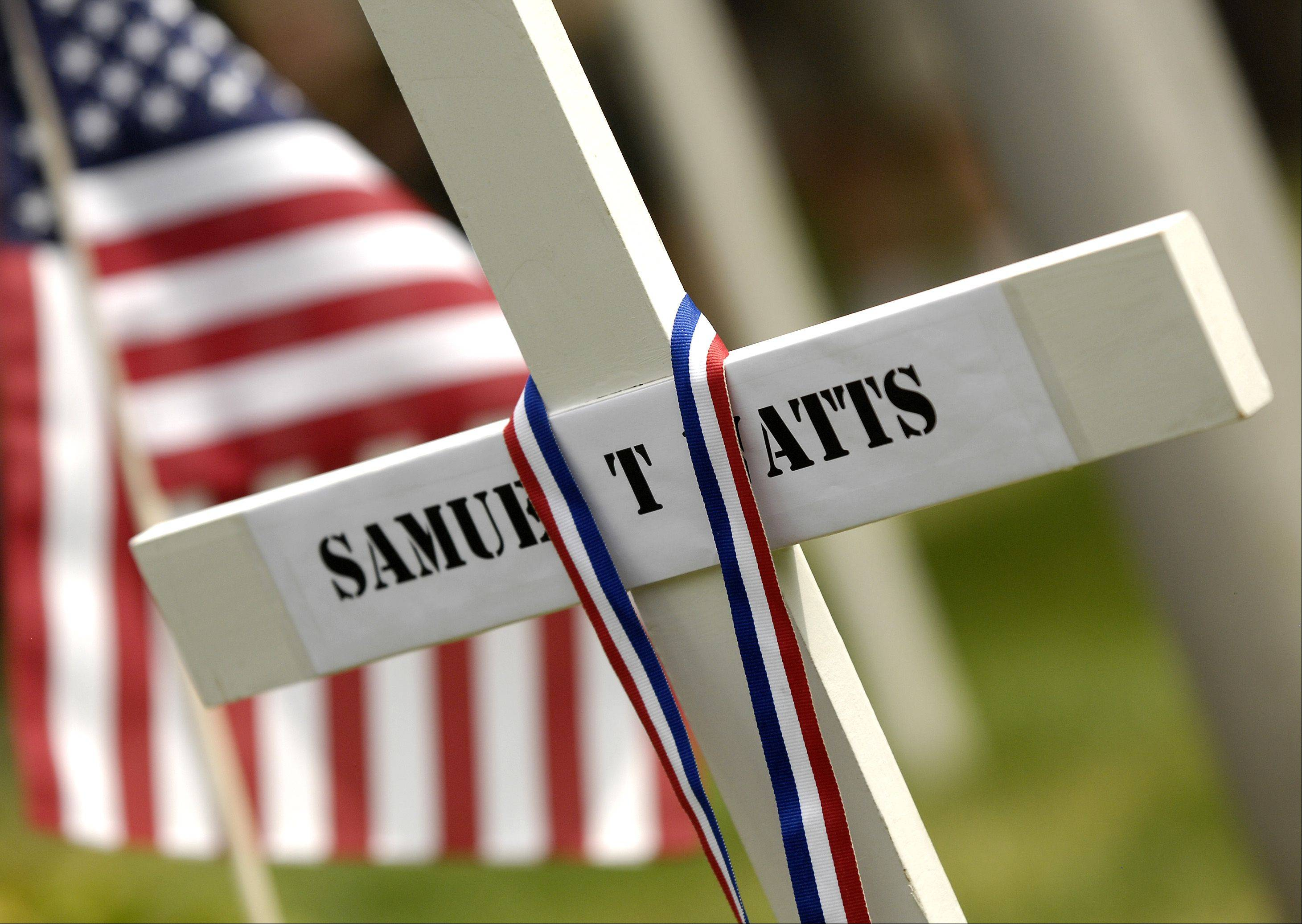 Mark Black/mblack@dailyherald.comA wooden cross in honor of U.S. Army Spc. Samuel Watts, who died Saturday from injuries he suffered last month from a roadside bomb in Afghanistan, was placed in the Wheaton Cemetery Monday by members of American Legion and Veterans of Foreign Wars.