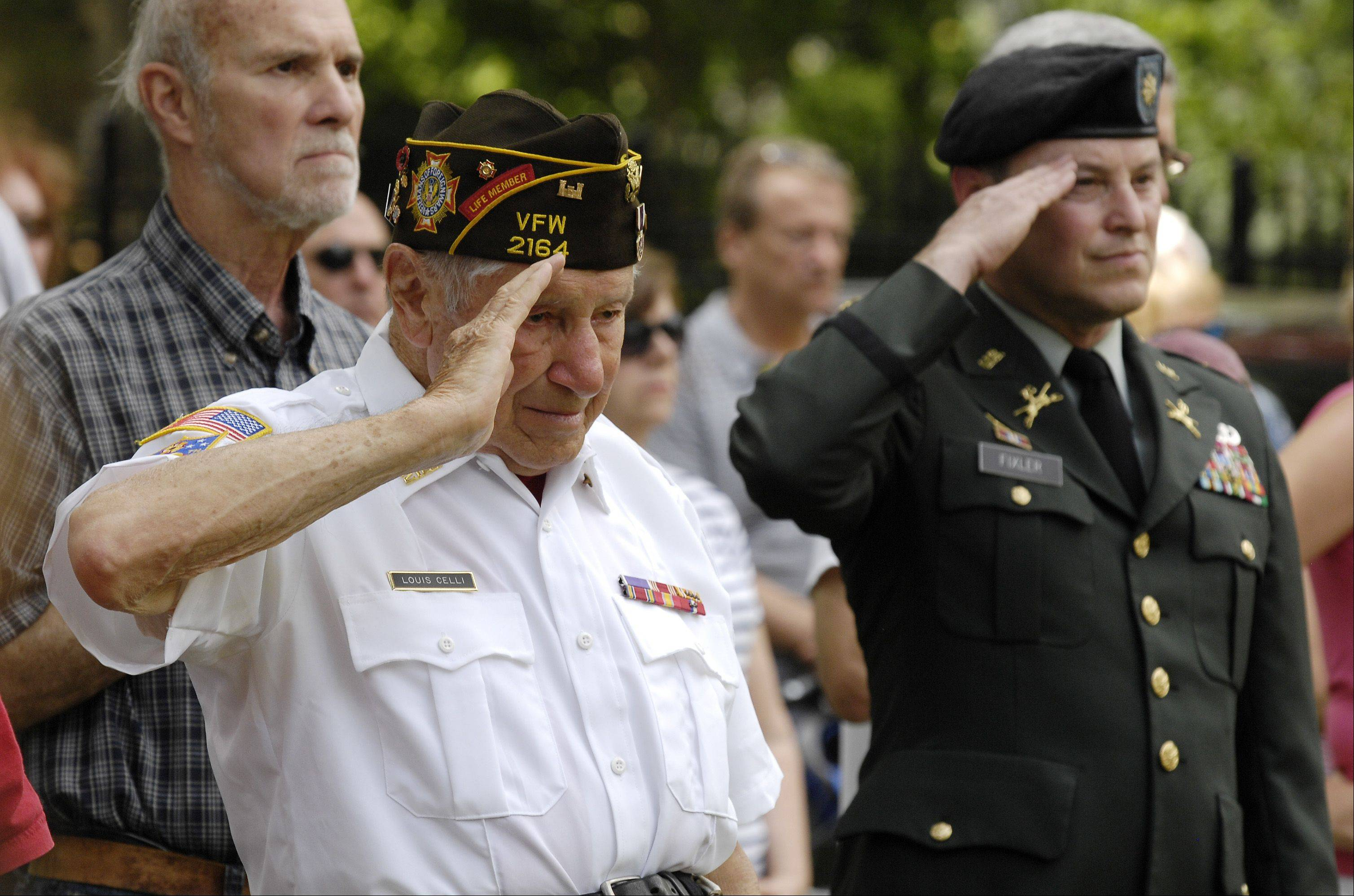 Veterans of Foreign Wars Post 2164 member Louis Celli, a World War II Army veteran, and Retired U.S. Army Major Steve Fixler, salute during the Wheaton Memorial Day ceremony at Wheaton Cemetery Monday.