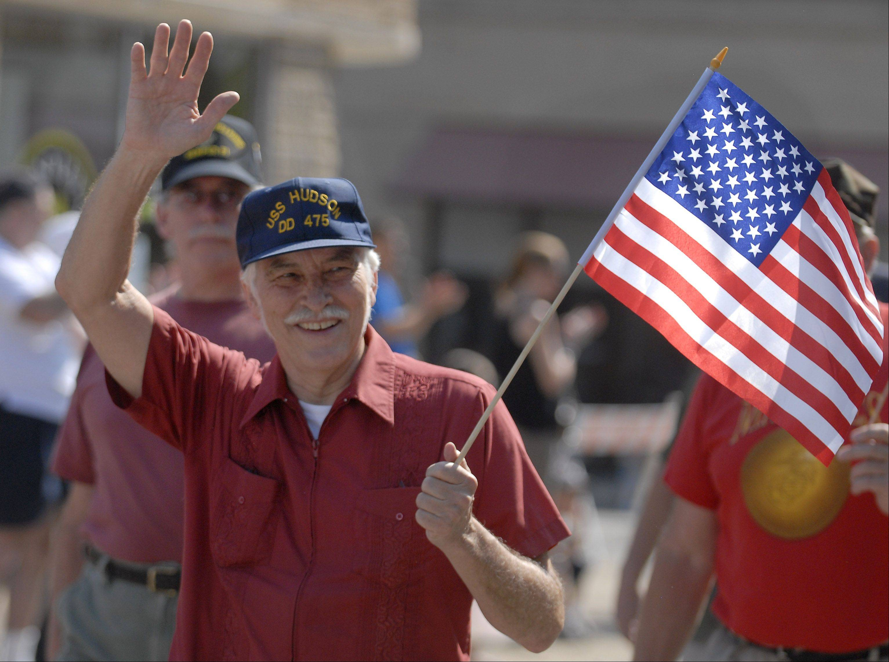 Steve Sharel of Arlington Heights marches with the Vietnam Veterans of America Chapter 311 at the Memorial Day parade in Monday in Arlington Heights. Sharel served onboard the carrier USS Enterprise as an Aviation Storekeeper during the Vietnam War.