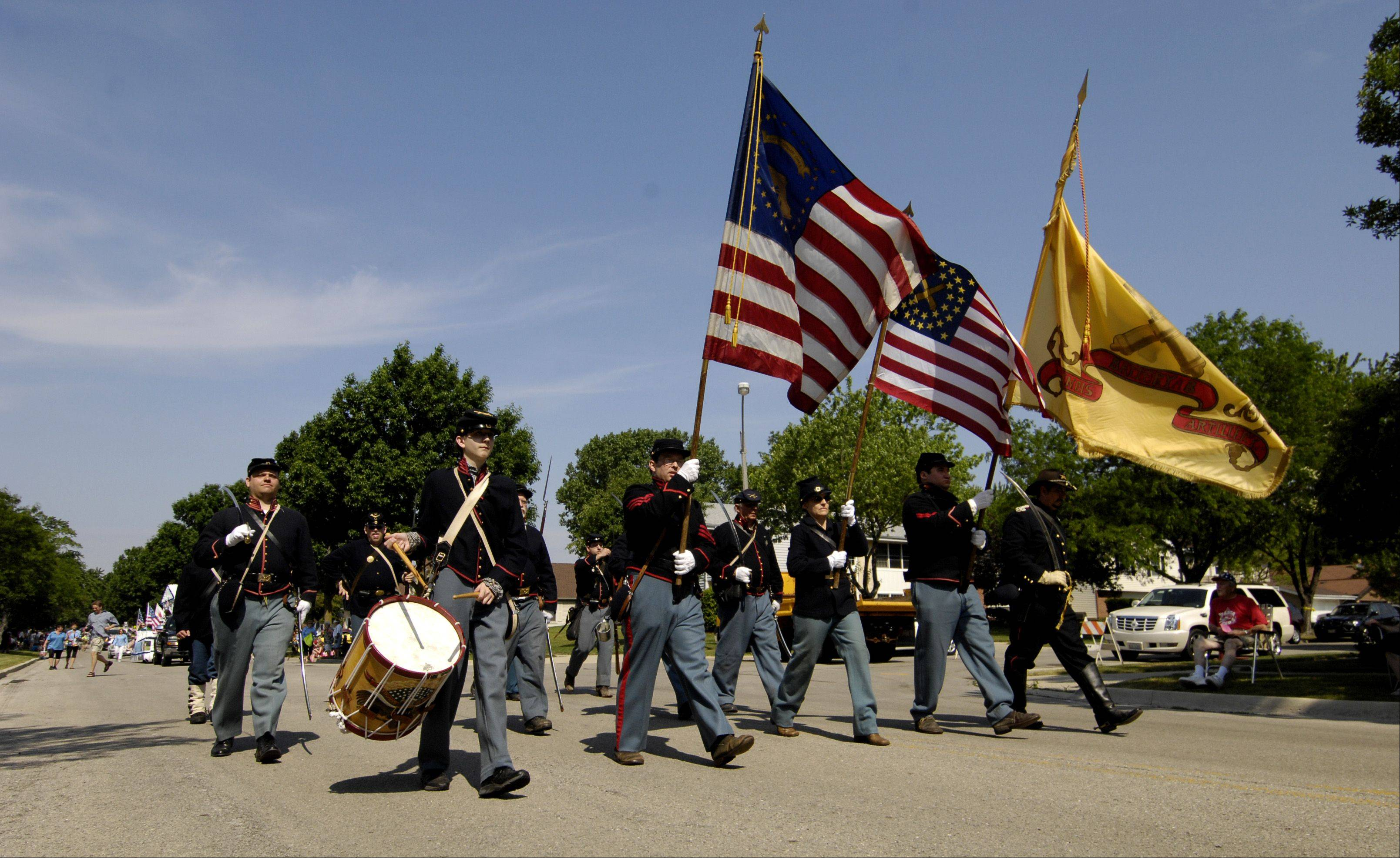 Members of the Civil War era Taylor's Battery B march in the Itasca Memorial Day parade on Monday.