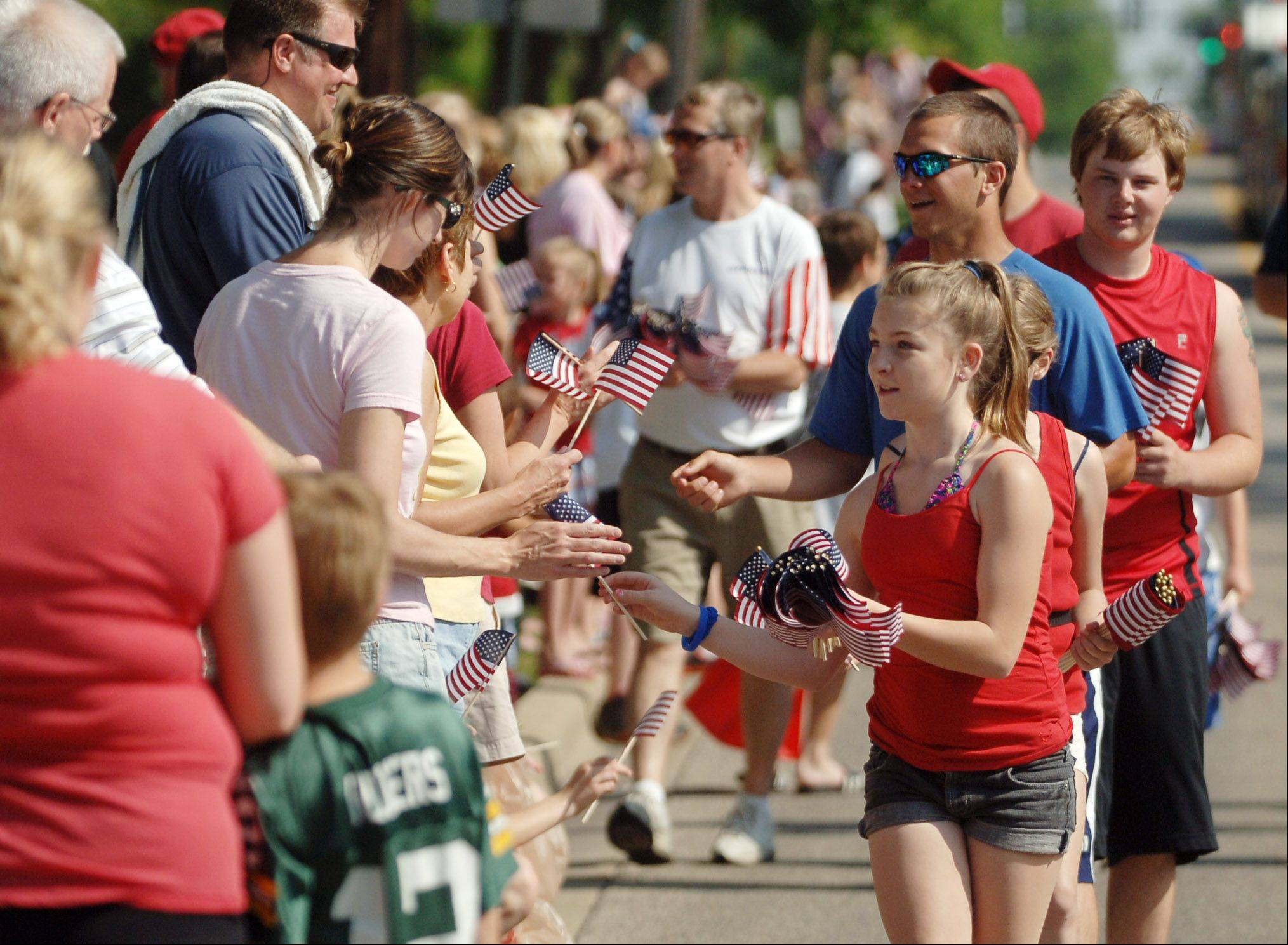 Flags were handed out to spectators at Grayslake's annual Memorial Day parade on Monday.