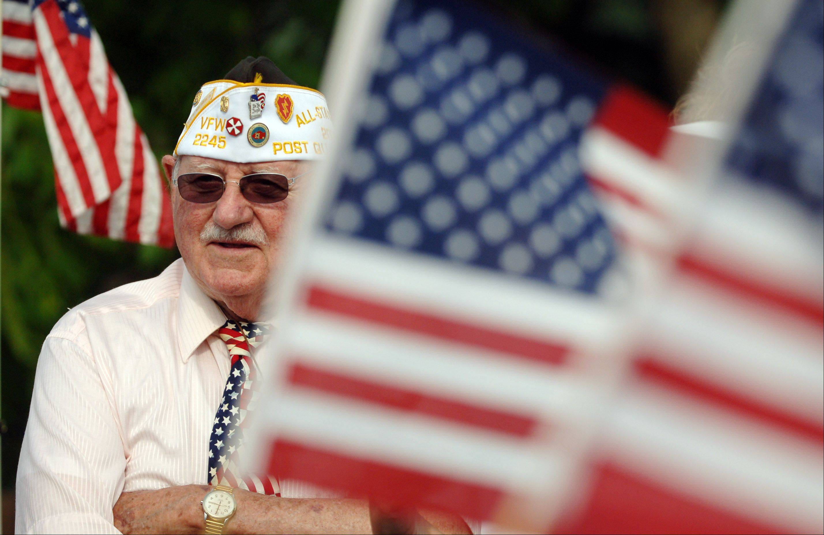 Bob Wegge of the VFW Post 2245 is surrounded by red, white and blue before the kickoff of Monday's Memorial Day parade in Grayslake.