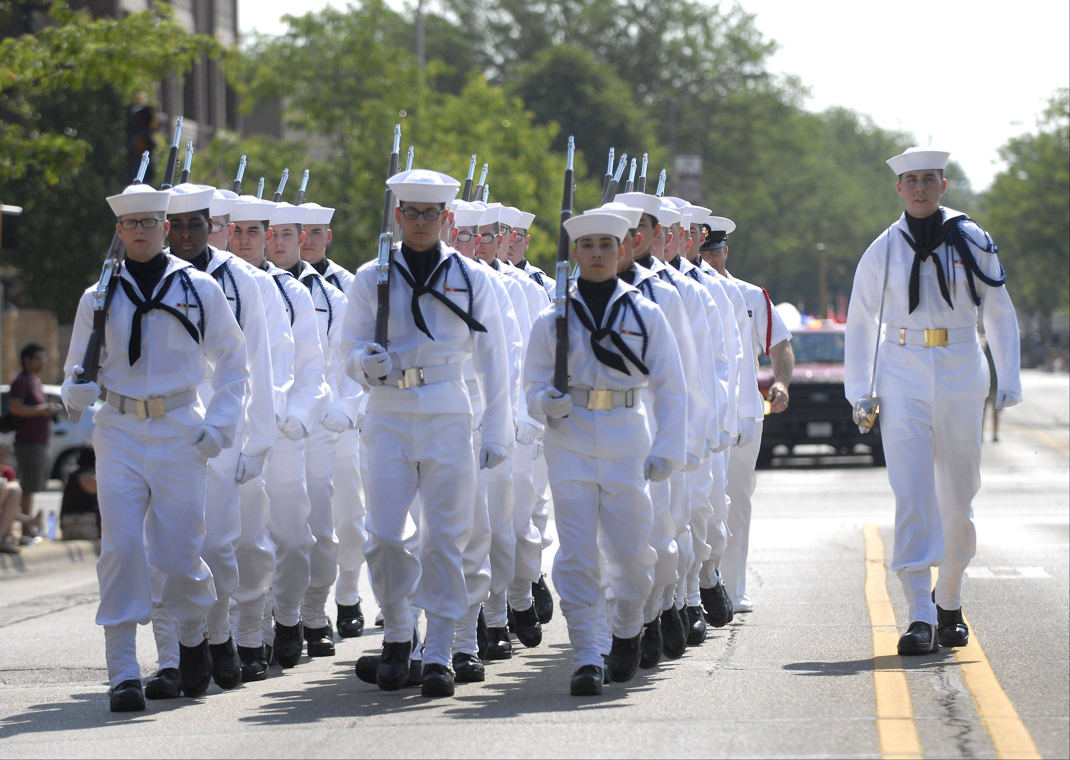 Sailors with the Recruit Training command from Great Lakes march in the Memorial Day parade in Monday in Arlington Heights.