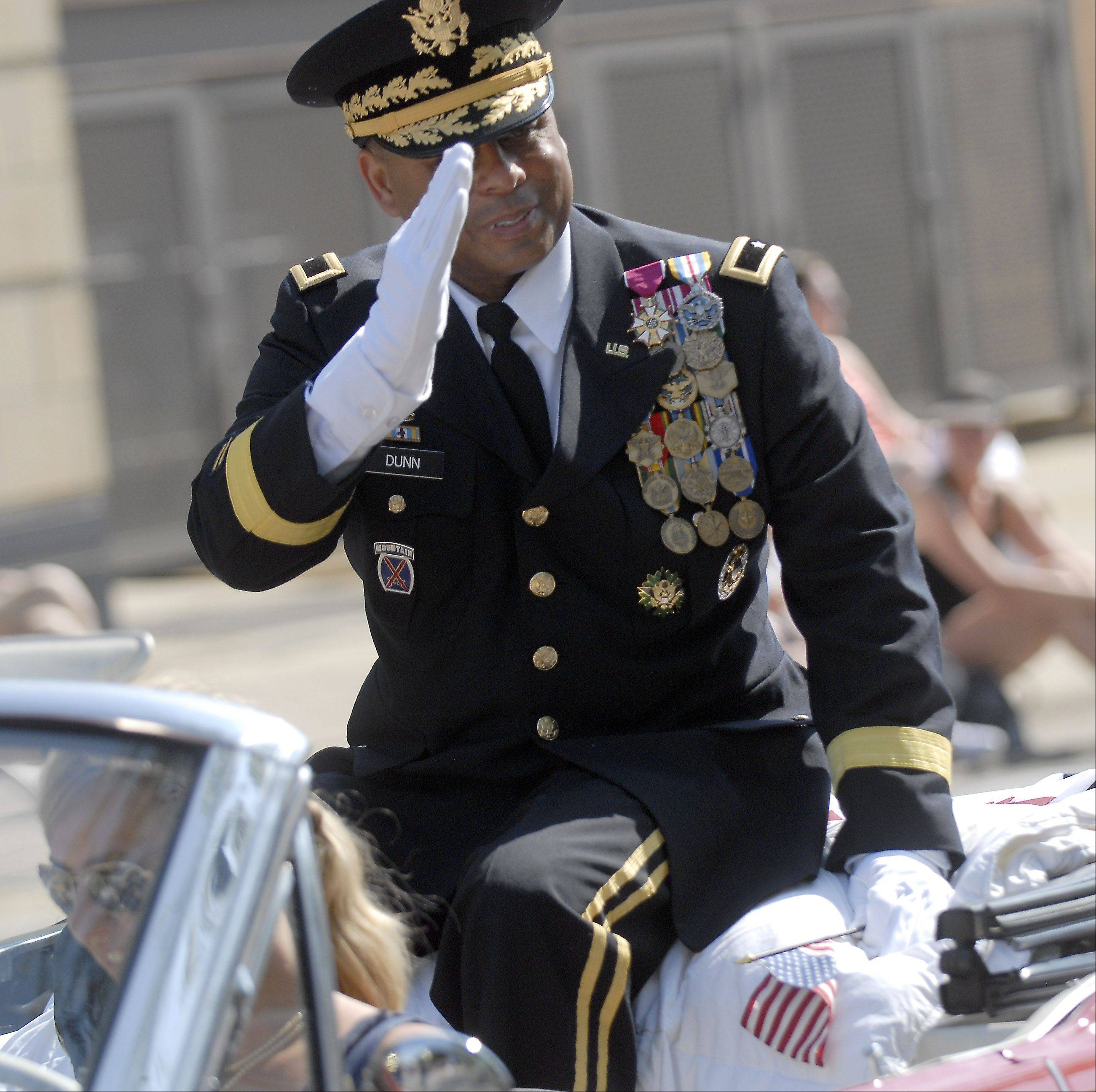 Brigadier General Gracus K. Dunn, Commanding General of the 85th Support Command, Arlington Heights salutes parade goers at the Memorial Day parade in Monday in Arlington Heights.