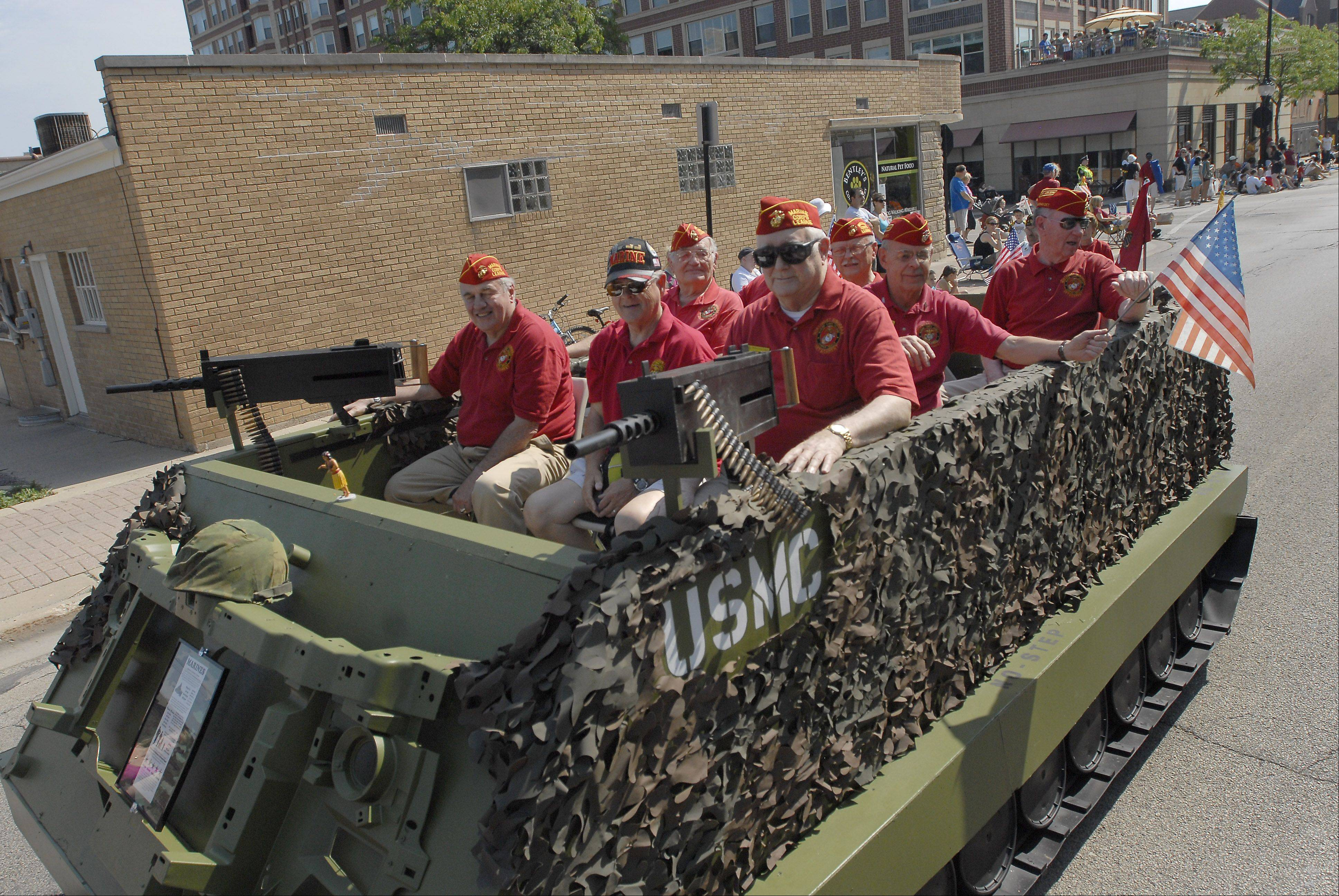 Members of the Marine Corps League ride in the Memorial Day parade in Monday in Arlington Heights.