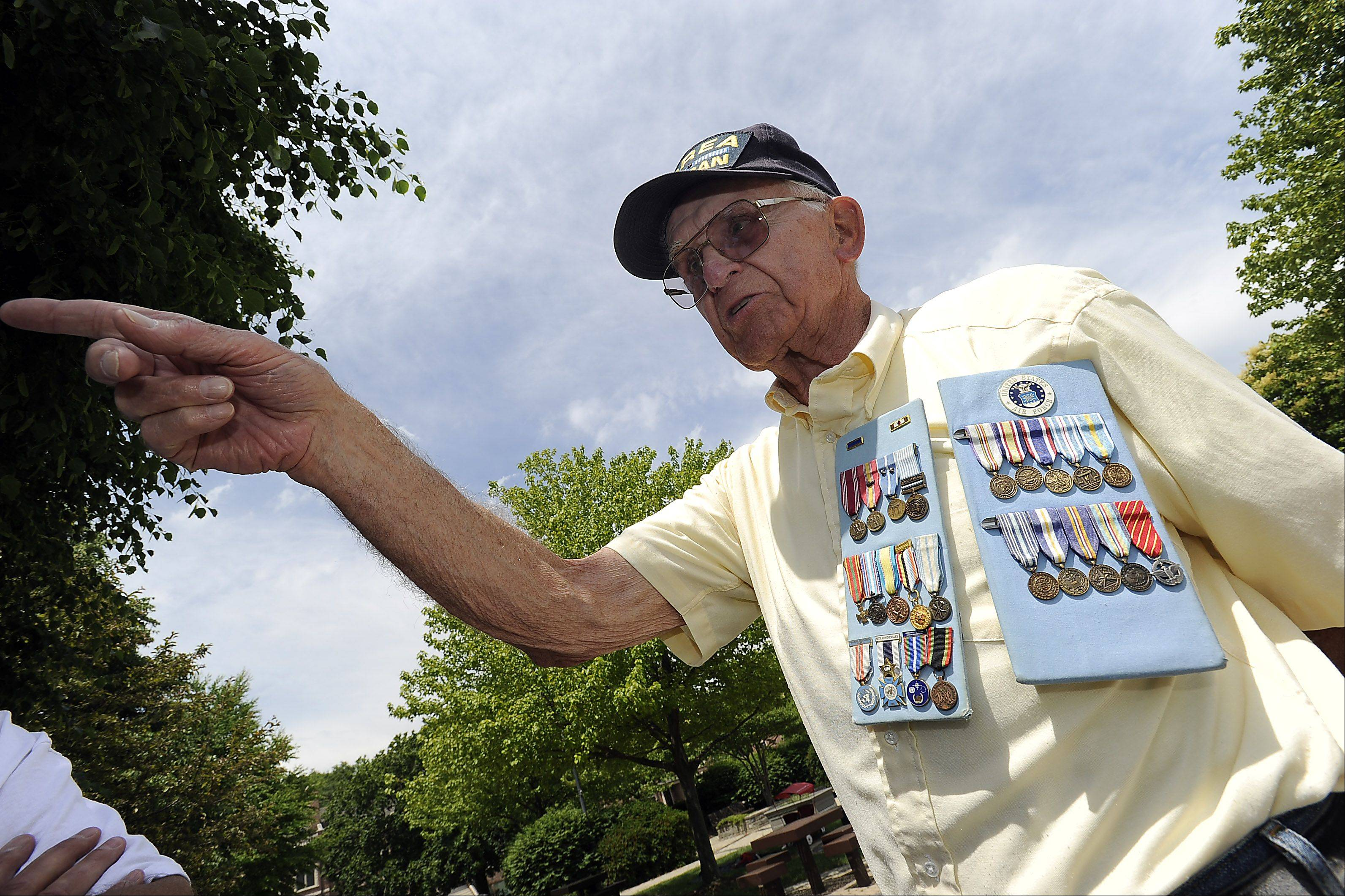 Korean War veteran Jere Crise of Palatine shows off his medals during Palatine's American Legion Post 690 ceremony held on Memorial Day in Towne Square on Monday.