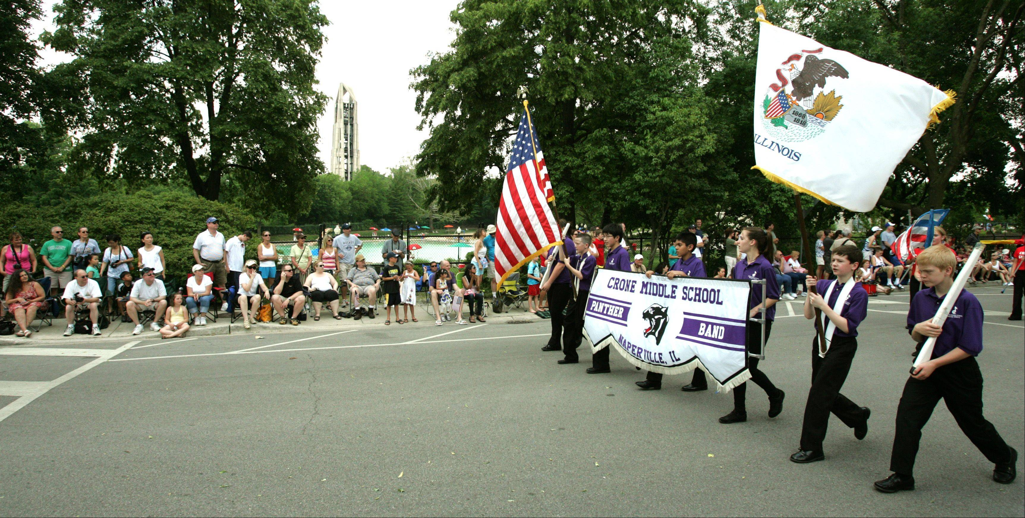 Members of the Crone Middle School band march in the Naperville Memorial Day parade.
