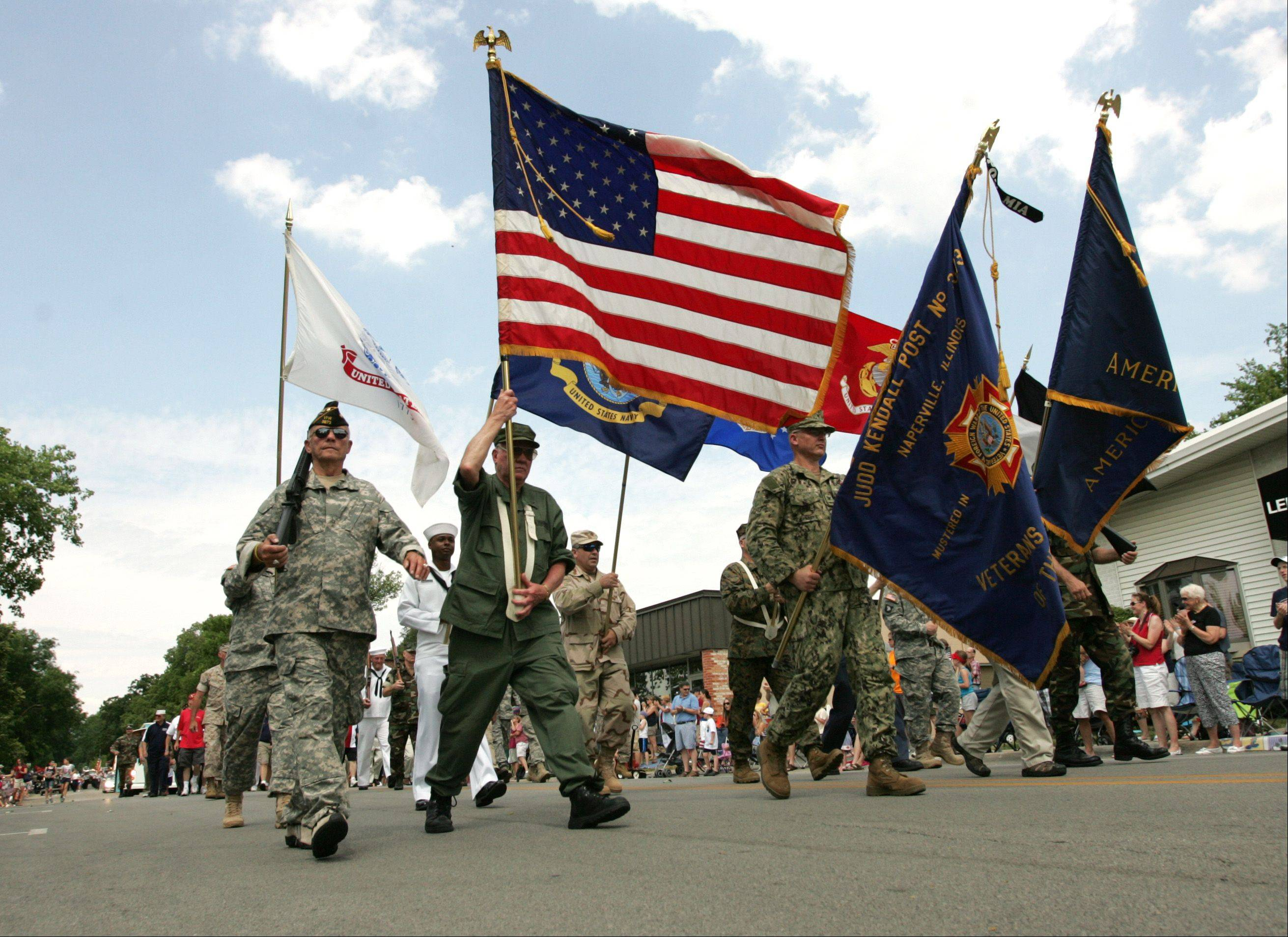Members of the Judd Kendall Post 3873 Veterans of Foreign Wars march in the Naperville Memorial Day parade.