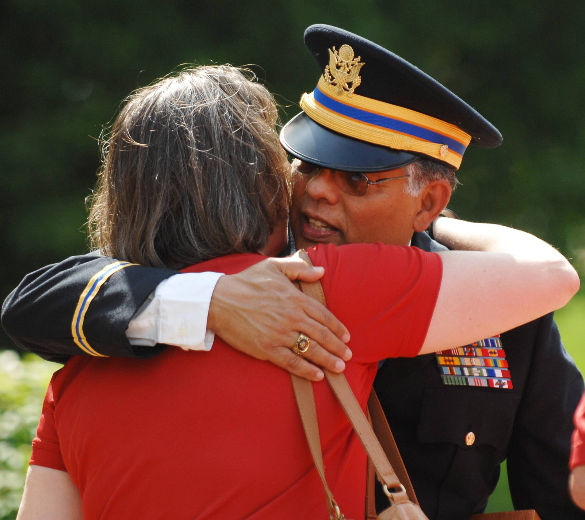 Ty Simmons, retired Vietnam and Iraq wars helicopter pilot and Silver Star recipient, hugs Mary Patterson, mother of the late Christopher Patterson, who was memorialized Monday at the Memorial Day ceremony sponsored by the Kane County Veterans Assistance Commission at the Government Center in Geneva.