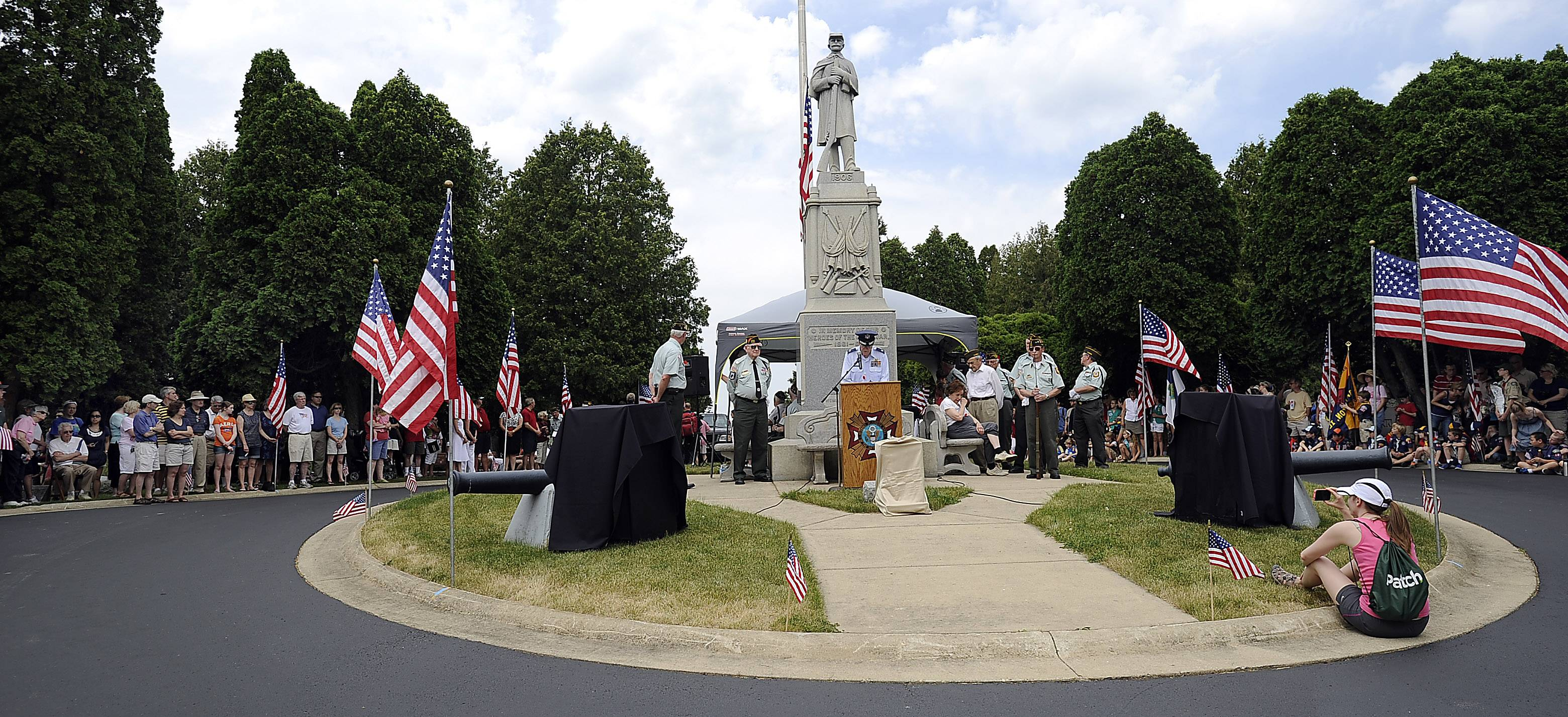 Barrington's Veterans of Foreign Wars officers of Post 7706 commemorate U.S. men and women who died while in military service to their country at Evergreen Cemetery during the Barrington Memorial Day ceremony on Monday.