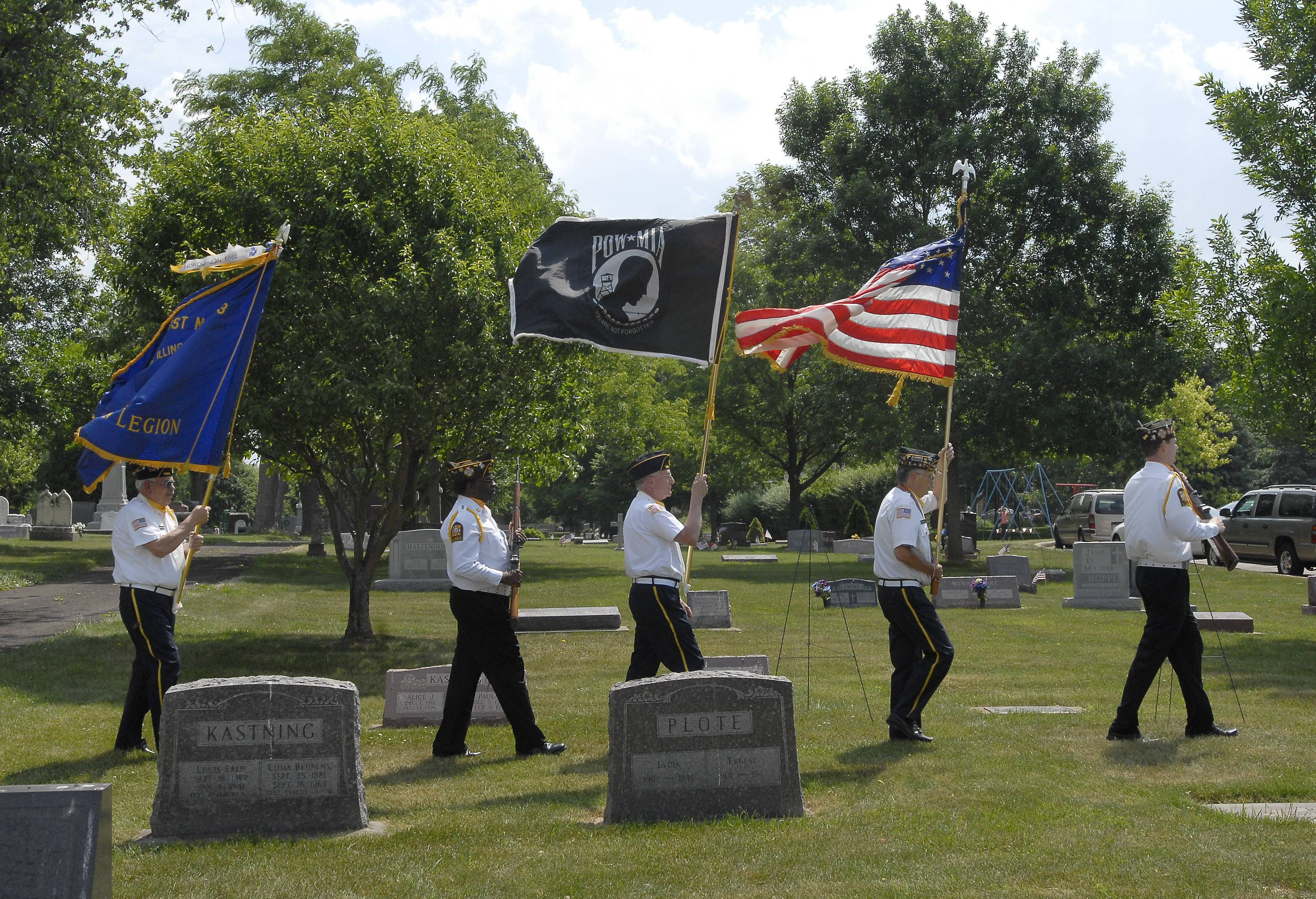 Veterans enter the cemetery Monday during the Memorial Day service at St. Peter's Lutheran Church in Schaumburg.
