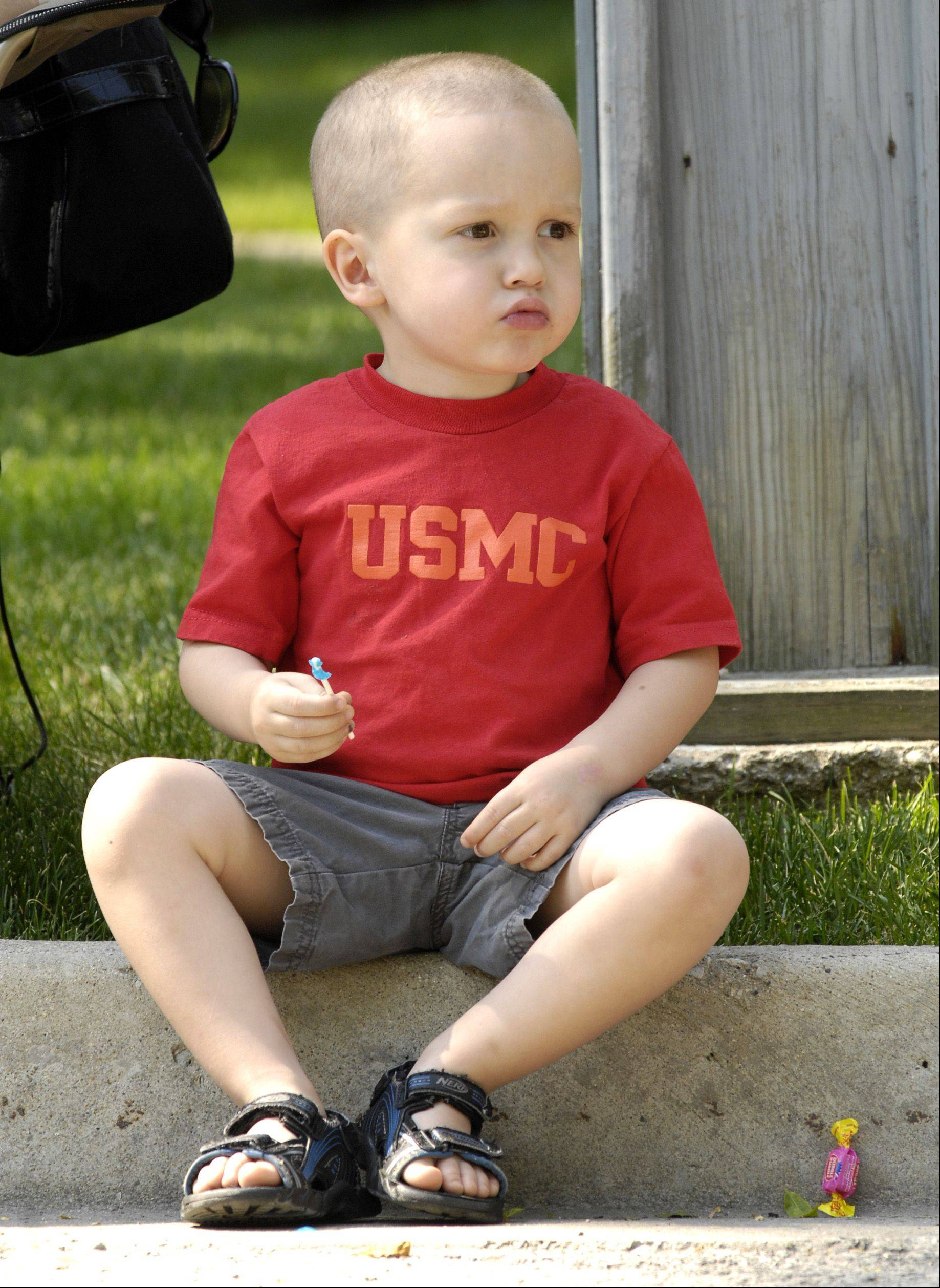 Caleb Cruz, 4 of Itasca, wears a United State Marine Corp shirt to honor his uncle who is serving in the Marines, as he attends the annual Memorial Day parade in Itasca on Monday.