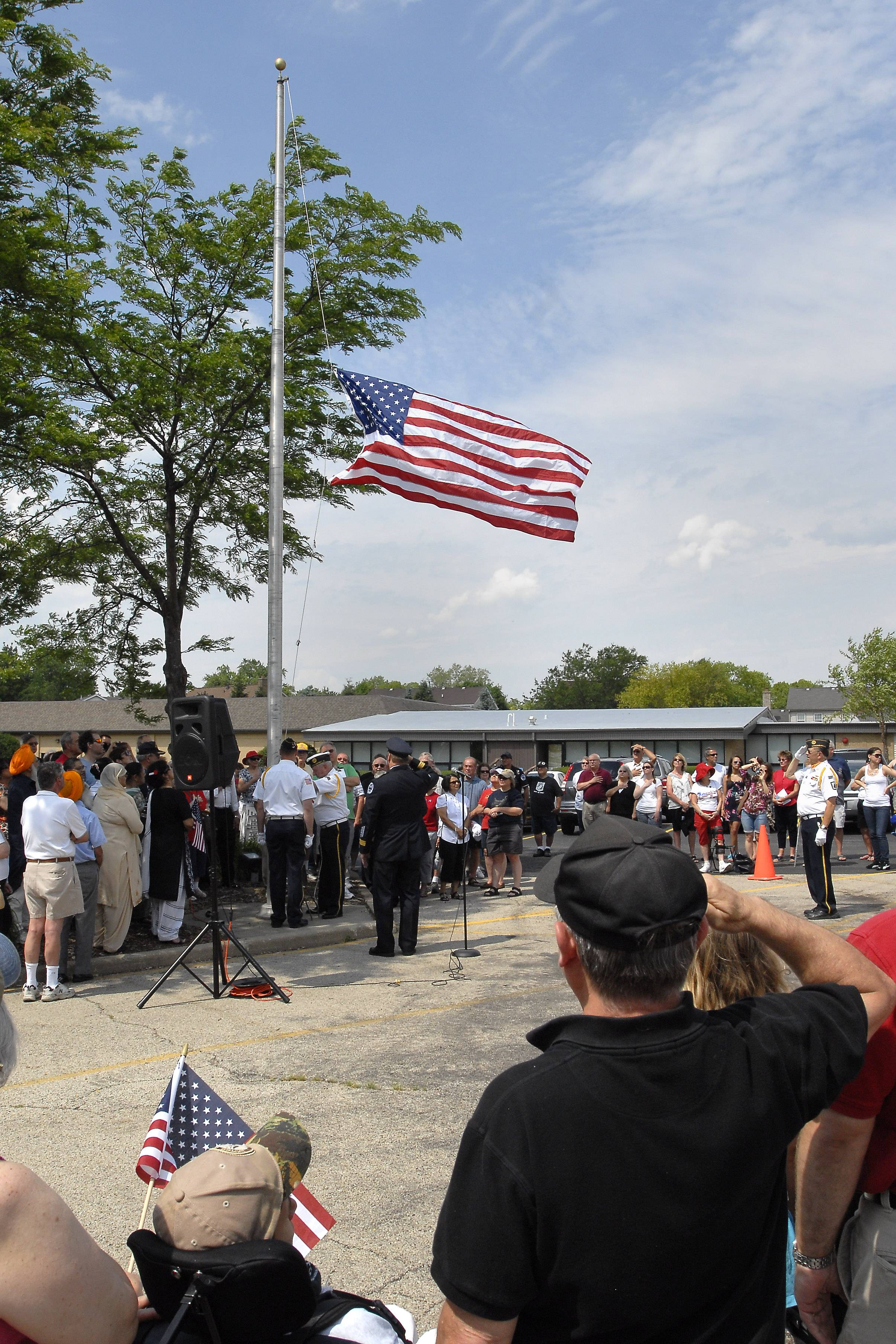 The flag is lowered to half-staff Monday during the Memorial Day service at the St. Peter's Lutheran Church cemetery in Schaumburg.