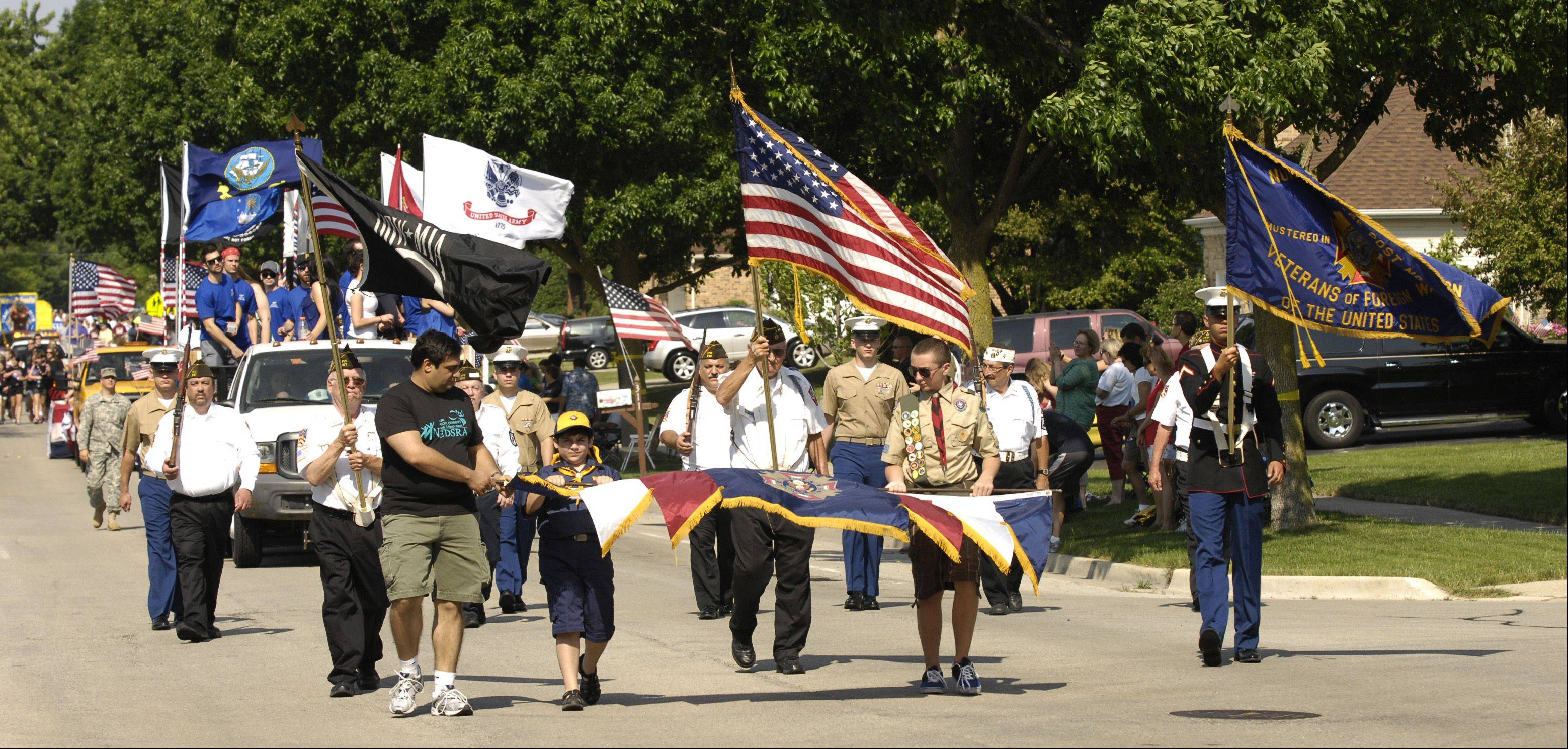 Members of VFW Post 5167 march in the Itasca Memorial Day parade on Monday.