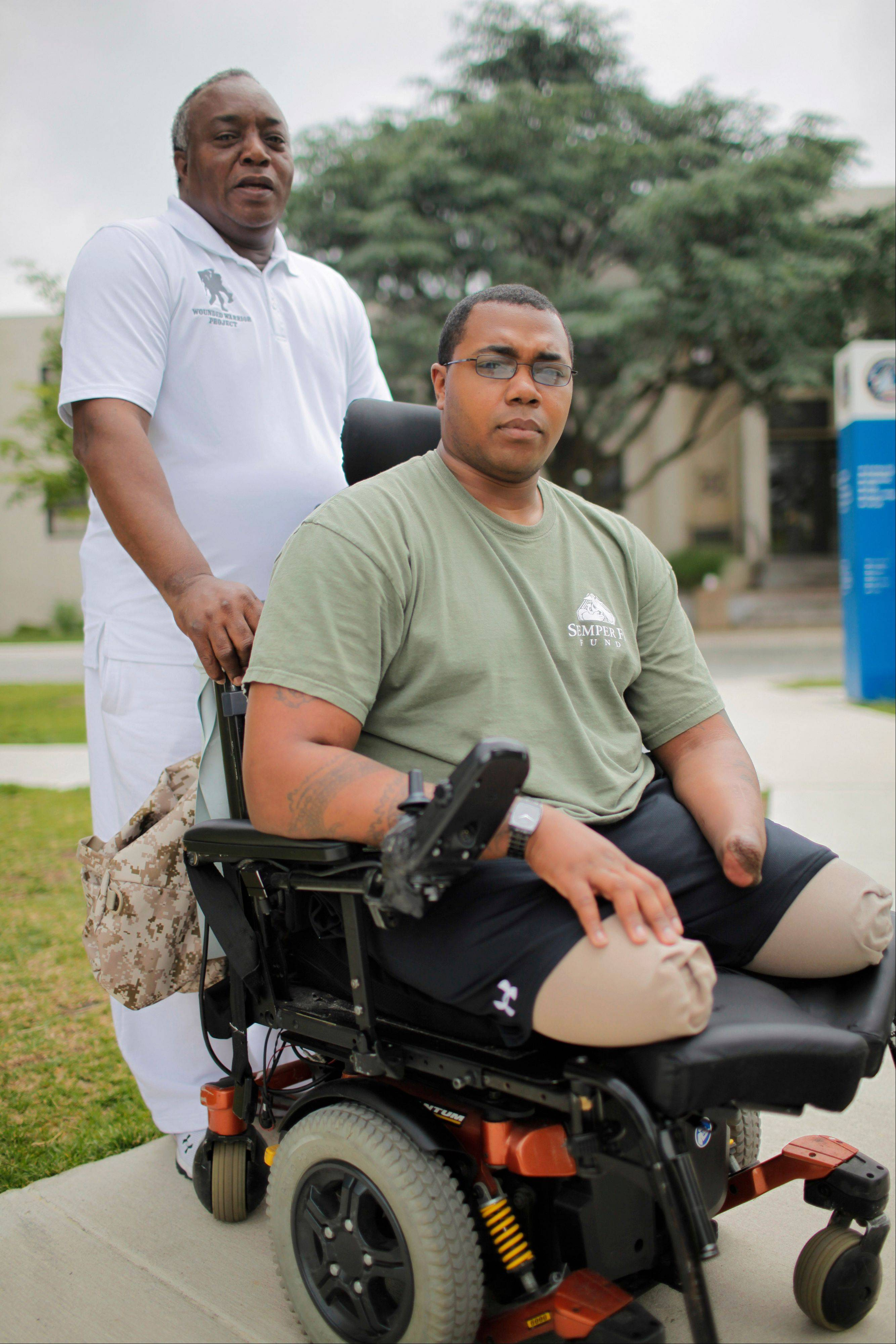 Larry Bailey, left, stands with his son, Marine Cpl. Larry Bailey II of Zion at Walter Reed National Military Medical Center in Bethesda, Md. After tripping a rooftop bomb in Afghanistan in June 2011, the 26-year-old Marine remembers flying into the air, then fellow troops attending to him. Bailey, who ended up a triple amputee, expects to get a hand transplant this summer. A staggering 45 percent of the 1.6 million veterans from the wars in Iraq and Afghanistan are now seeking compensation for disabilities they say are service-related -- more than double the 21 percent who filed such claims after some previous wars, according to top government officials. The new veterans have different types of injuries than previous veterans did, in part because improvised bombs have been the main weapon and because body armor and improved battlefield care allowed many of them to survive wounds that in past wars proved fatal.