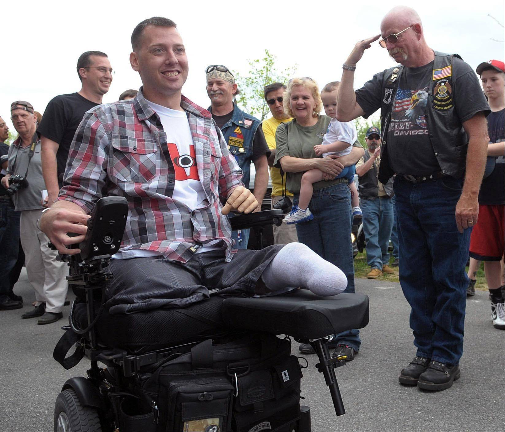 U.S. Army Sgt. Adam Keys, left, who was wounded in Afghanistan in 2010, is greeted by hundreds of community members during a homecoming ceremony at Cementon Park in Whitehall Township, Pa., on April 21. A staggering 45 percent of the 1.6 million veterans from the wars in Iraq and Afghanistan are now seeking compensation for disabilities they say are service-related -- more than double the 21 percent who filed such claims after some previous wars, according to top government officials. The new veterans have different types of injuries than previous veterans did, in part because improvised bombs have been the main weapon and because body armor and improved battlefield care allowed many of them to survive wounds that in past wars proved fatal.