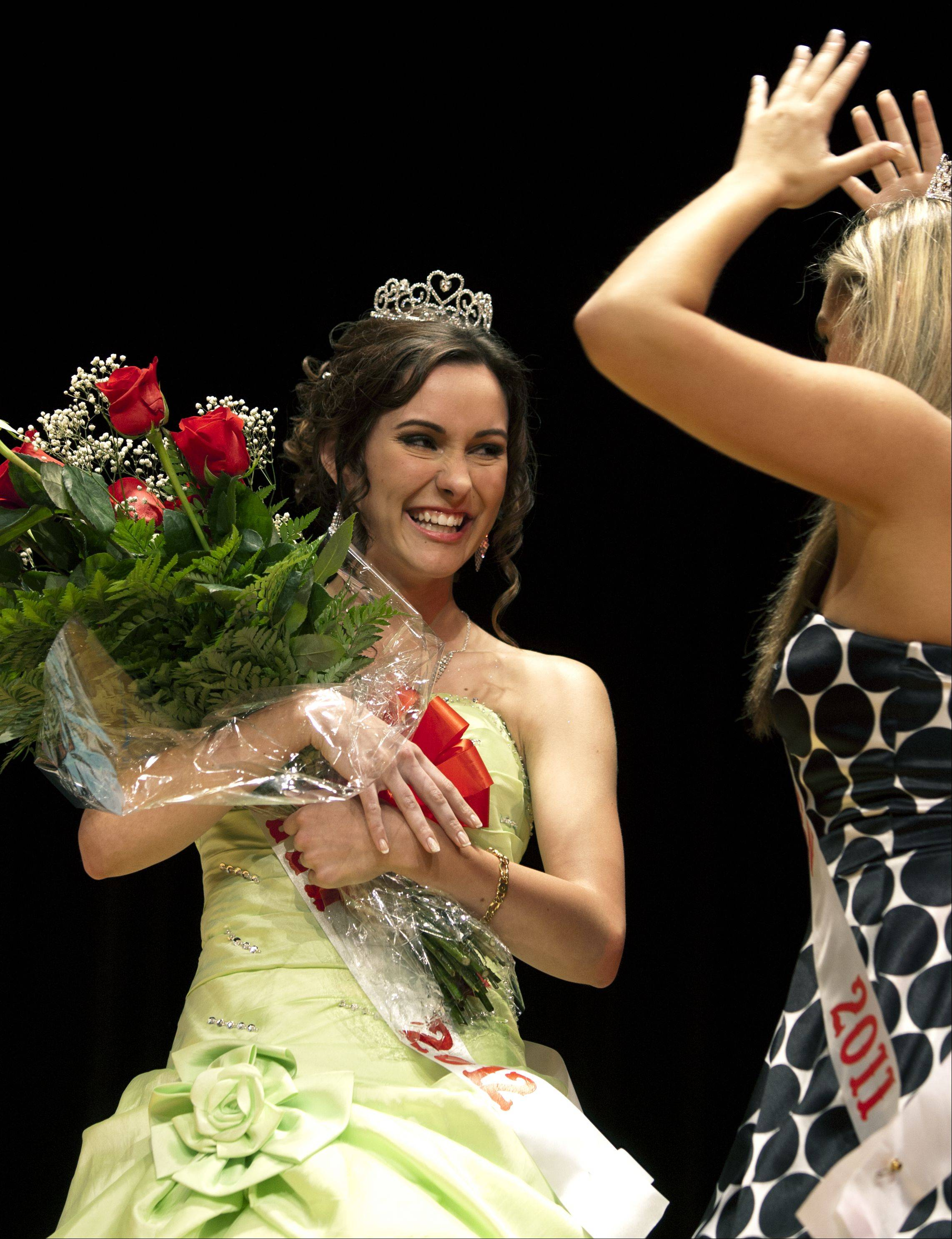 Katie Ruby is named the 53rd annual Rose Queen Pageant winner, during a competition at Lake Park High School West Campus. Lauren Caputo, right, 2011 Rose Queen, crowns the new winner.