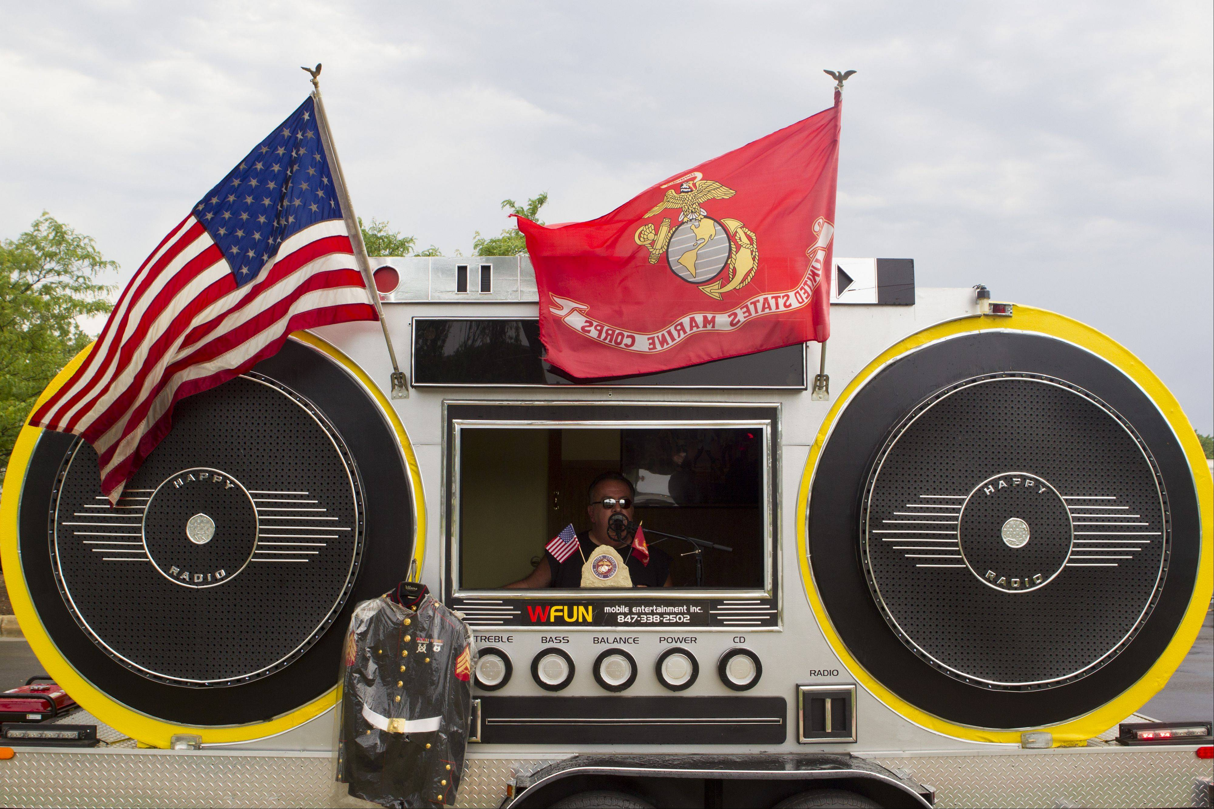 "Sal Gerone sits in his ""Monster Boom Box"" and played patriotic music during Rolling Meadows Memorial Day's parade in honor of all veterans, deceased, and those still serve the United States."