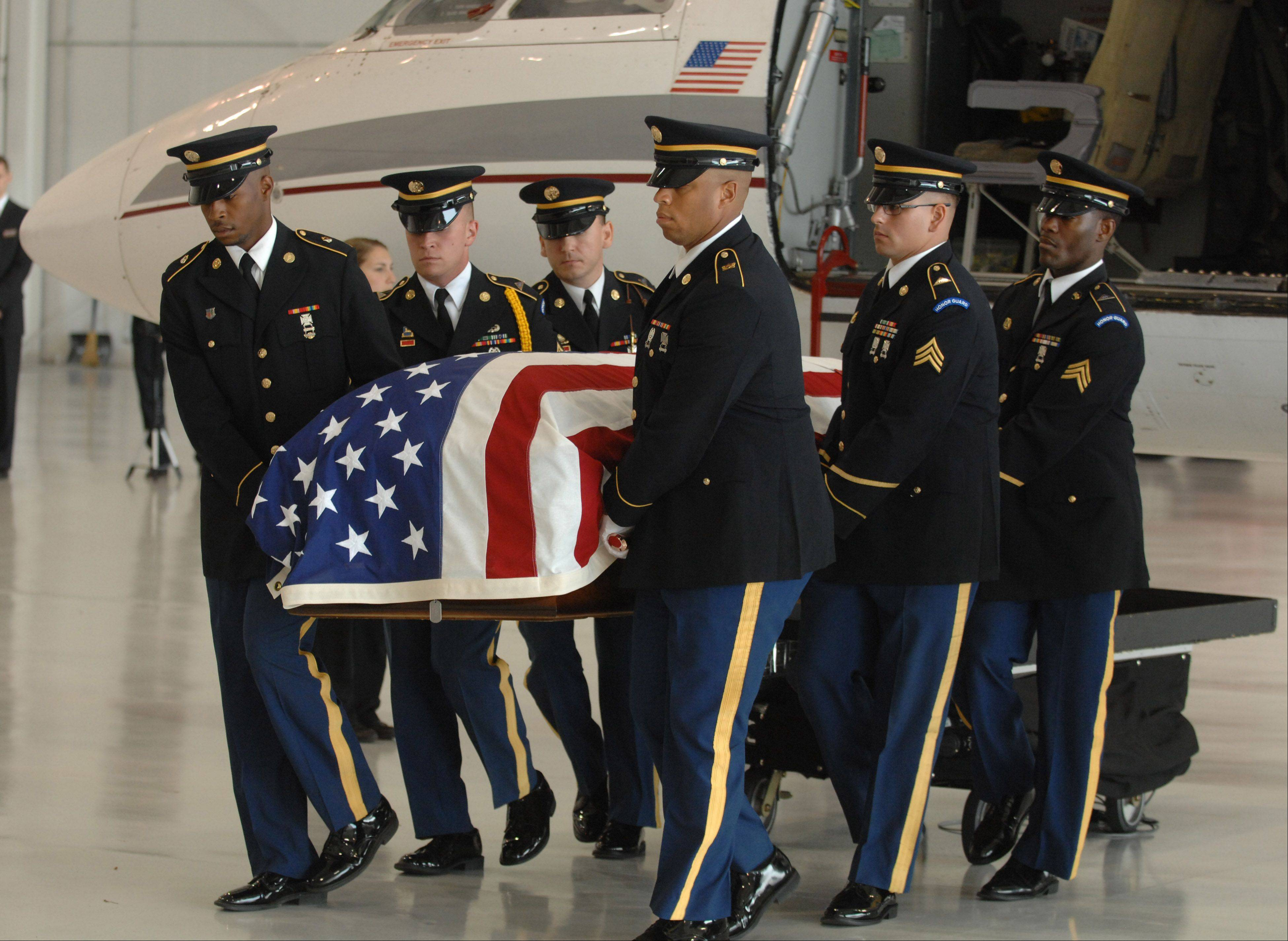 The body of U.S. Army Spec. Samuel T. Watts is brought home through the DuPage Airport in West Chicago Saturday. He was from Wheaton.