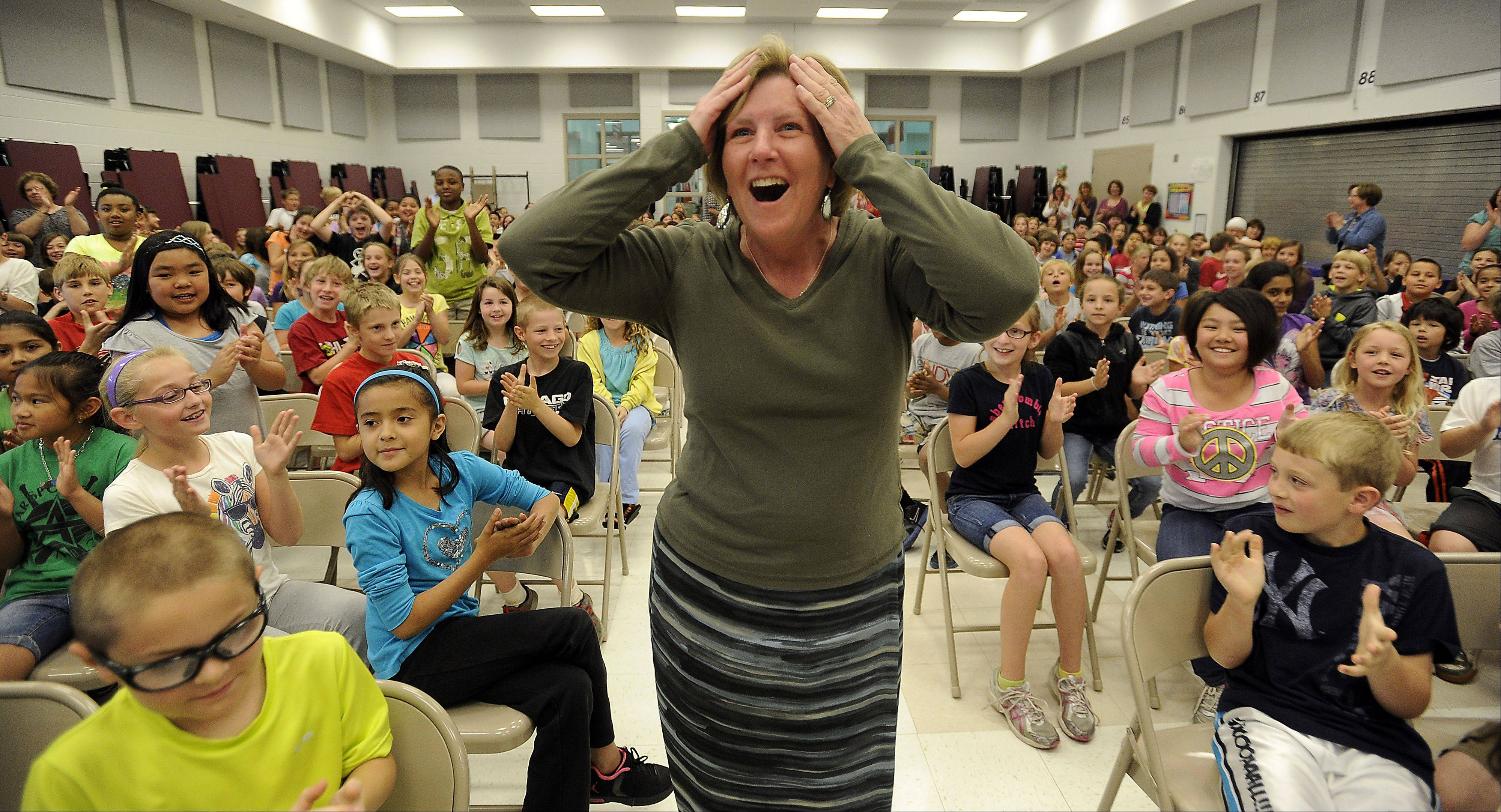 "Countryside School nurse Mary Anne Wesoloski of Barrington Hills is surprised by the student body as she is presented with the ""Excellence in Pediatric Care"" award from the Illinois Department of Public Health in an early morning celebration."