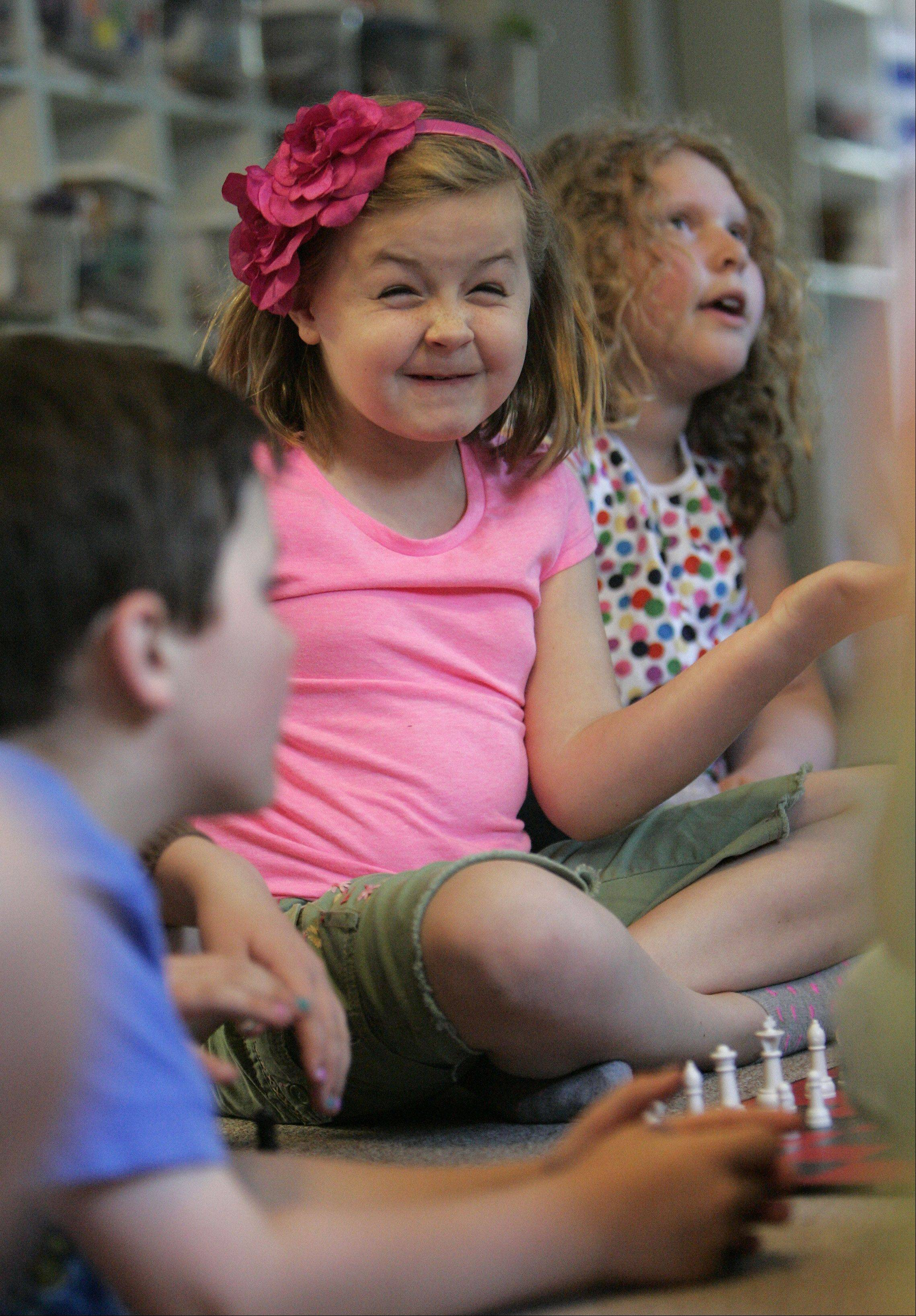 Seven-year-old Chloe Rockenhauser of Elgin, reacts during a game of chess at Children's House Montessori School in West Dundee Tuesday May 22, 2012. The school which has been open for 21 years averages about 40-50 students each year.