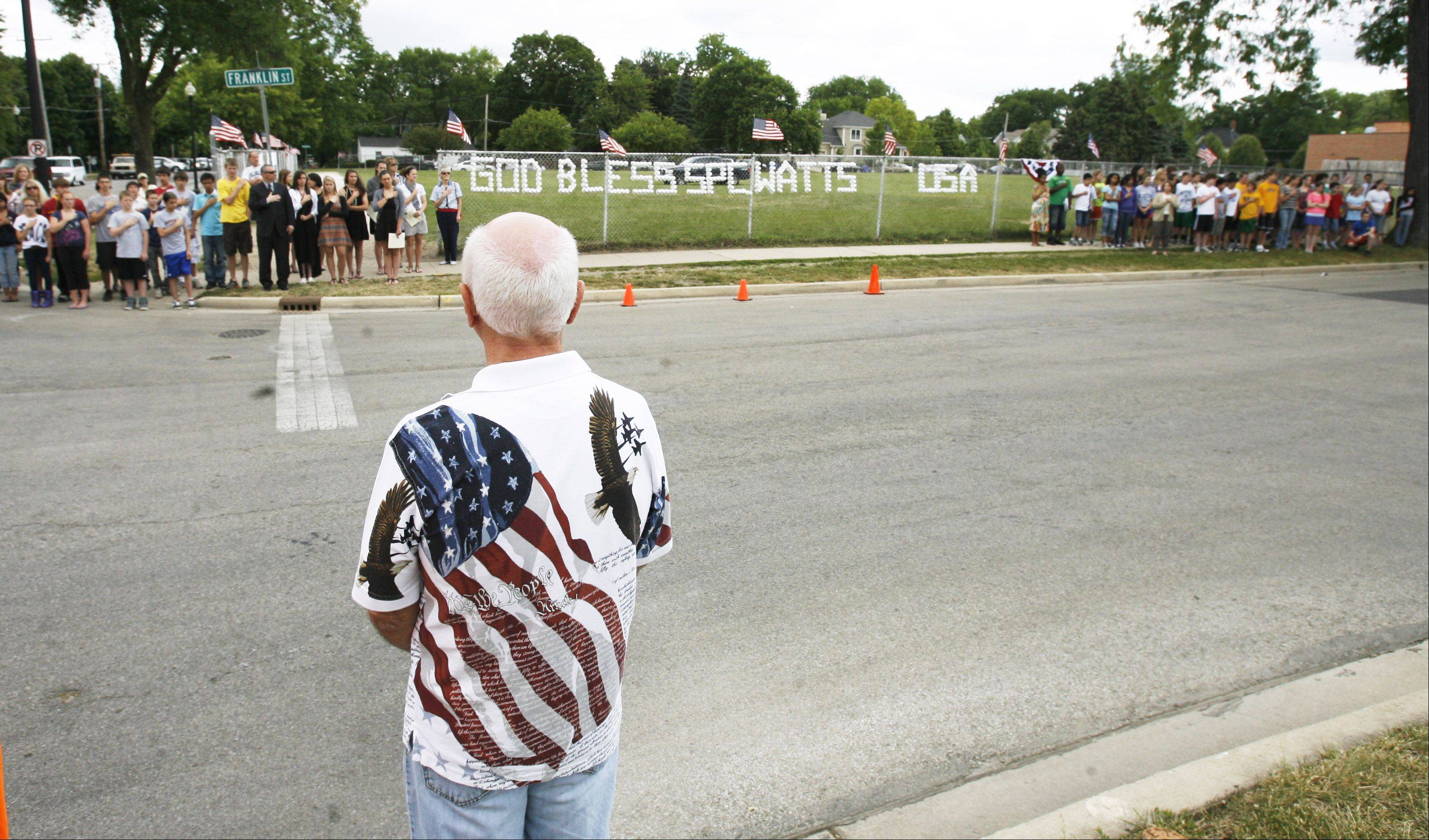 Michael Lance of Carol Stream pays respects to Army Spc. Samuel Watts of Wheaton.