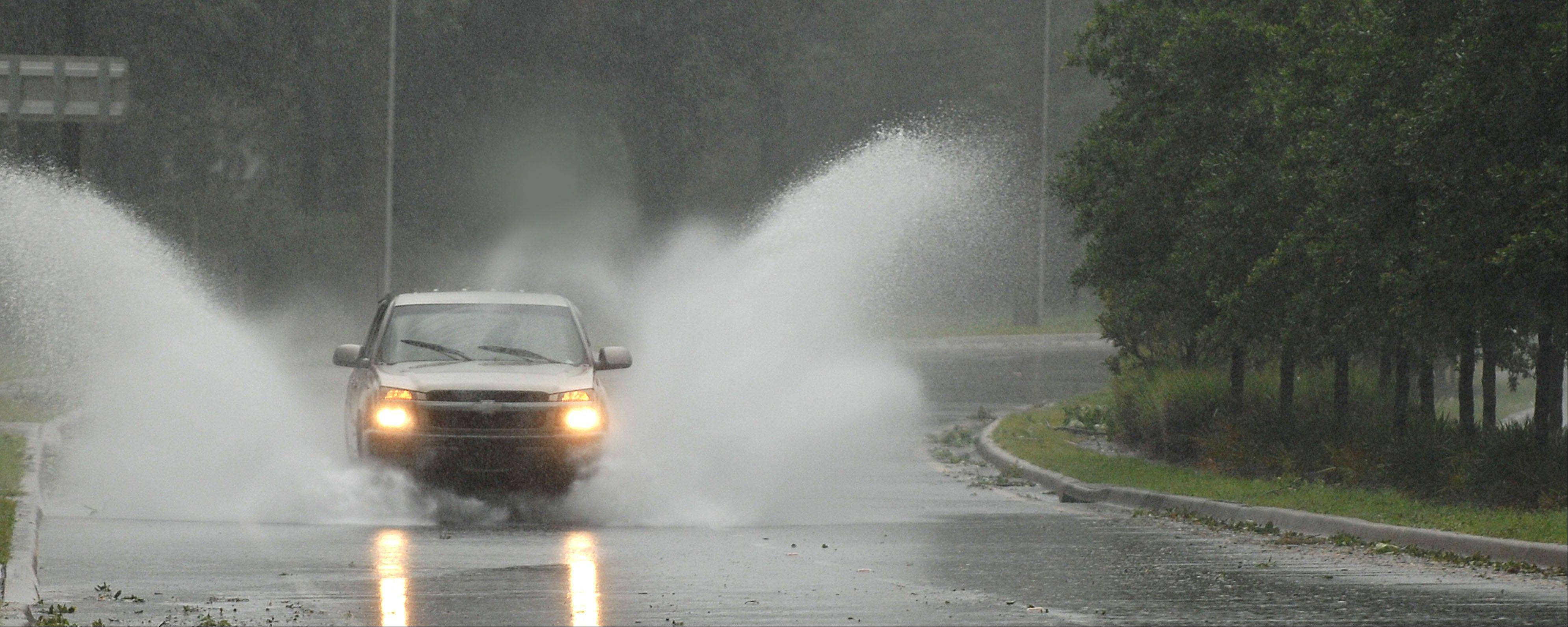 A truck plows through standing water in Jacksonville, Fla., Monday as Tropical Storm Beryl blew through.