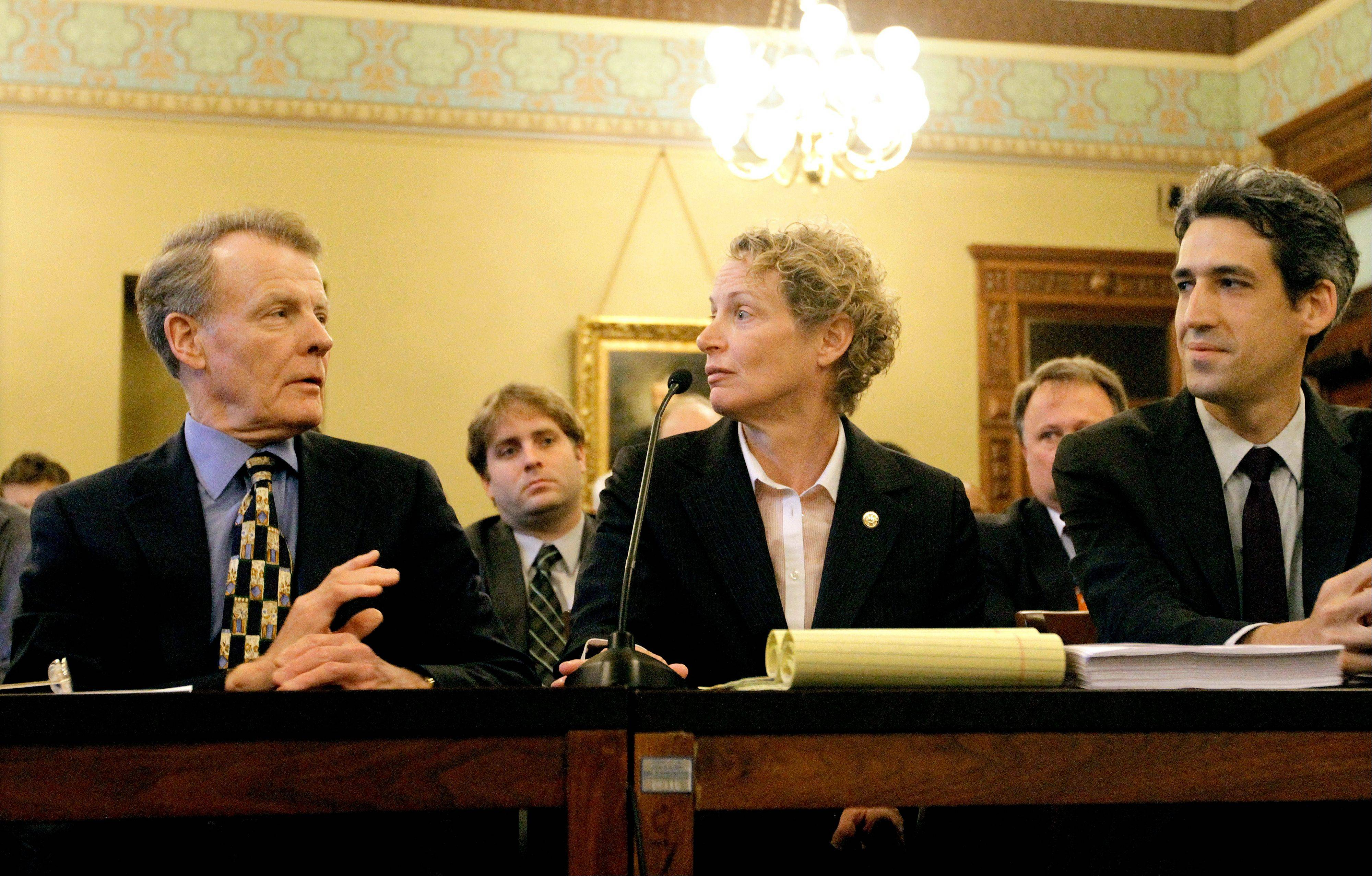 Illinois speaker of the House Michael Madigan, a Chicago Democrat, left, Rep. Elaine Nekritz, a Northbrook Democrat, and Rep. Daniel Biss, a Skokie Democrat, confer Tuesday before testifying during a House Personnel and Pensions Committee hearing at the Illinois State Capitol in Springfield. Lawmakers began acting on legislation to cut pensions for hundreds of thousands of public employees and make school districts take over retirement costs for their employees on Tuesday.