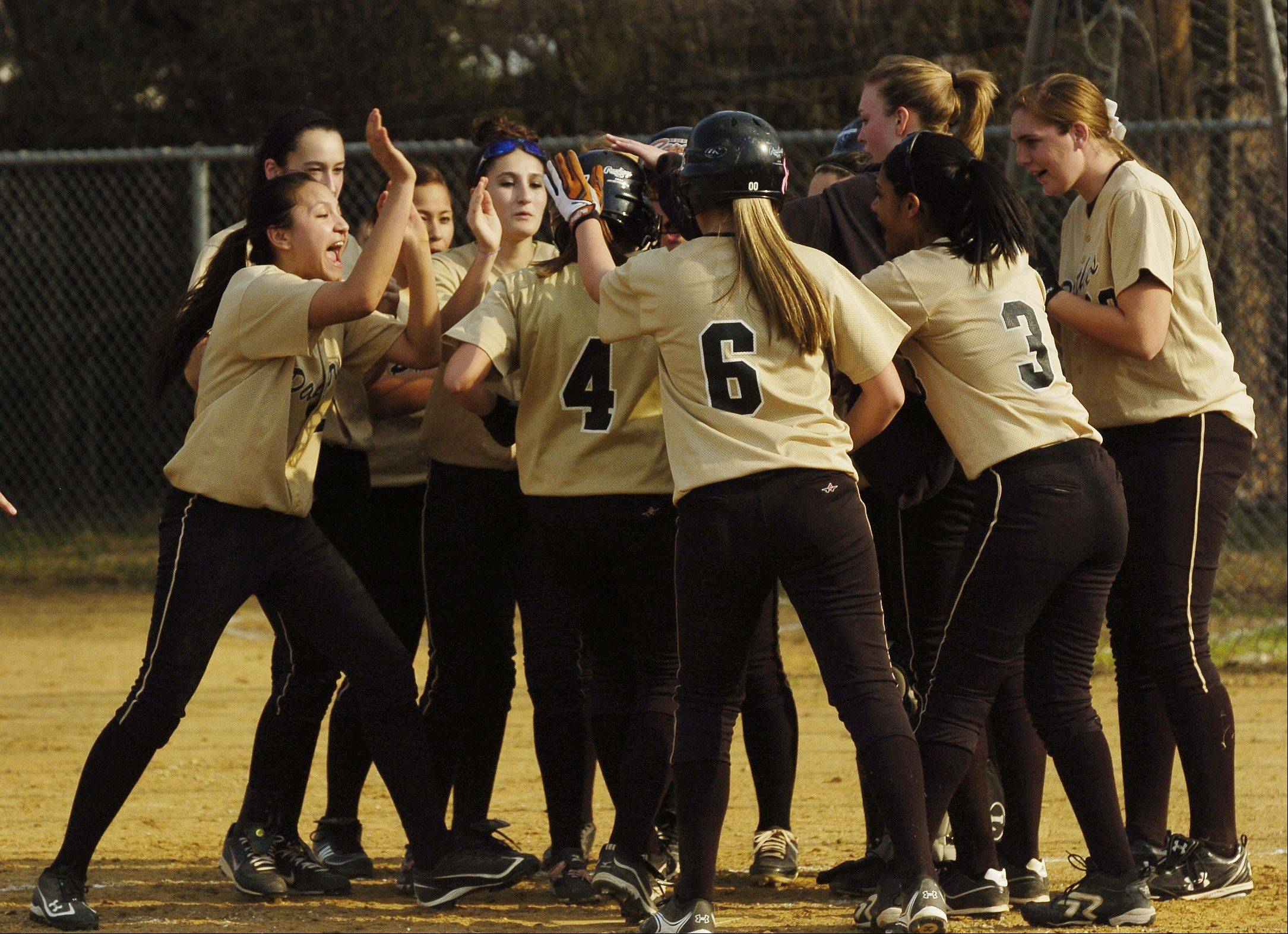 Glenbard North celebrates a two run homer in the first by Kelsey Muller against Lake Park High School during varsity softball in Roselle, Wednesday.