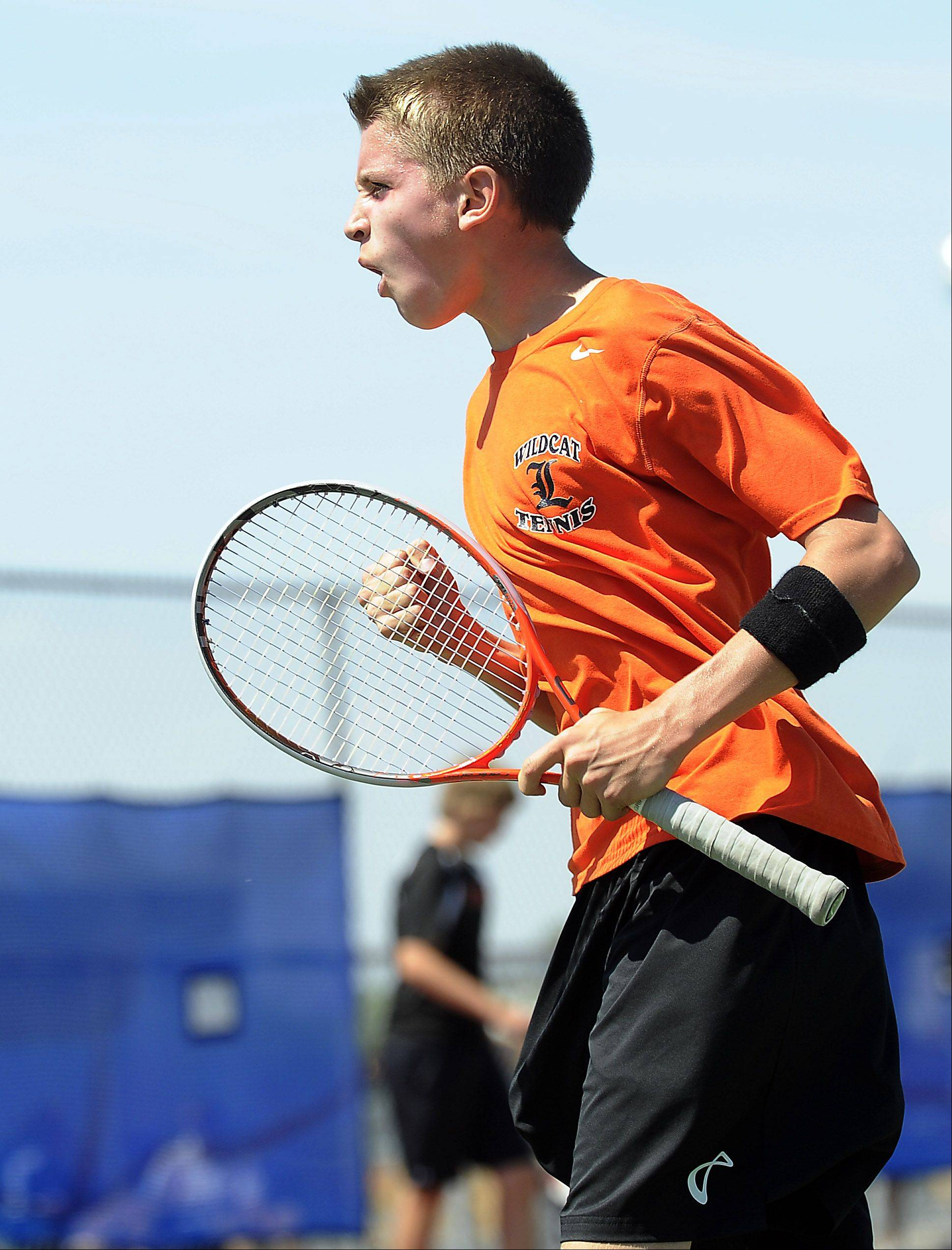 Libertyville's Ben VanDixhorn is pumped after he scored against Rockford's Matt Papke in the boys state tennis match at Hoffman Estates High School on Thursday.