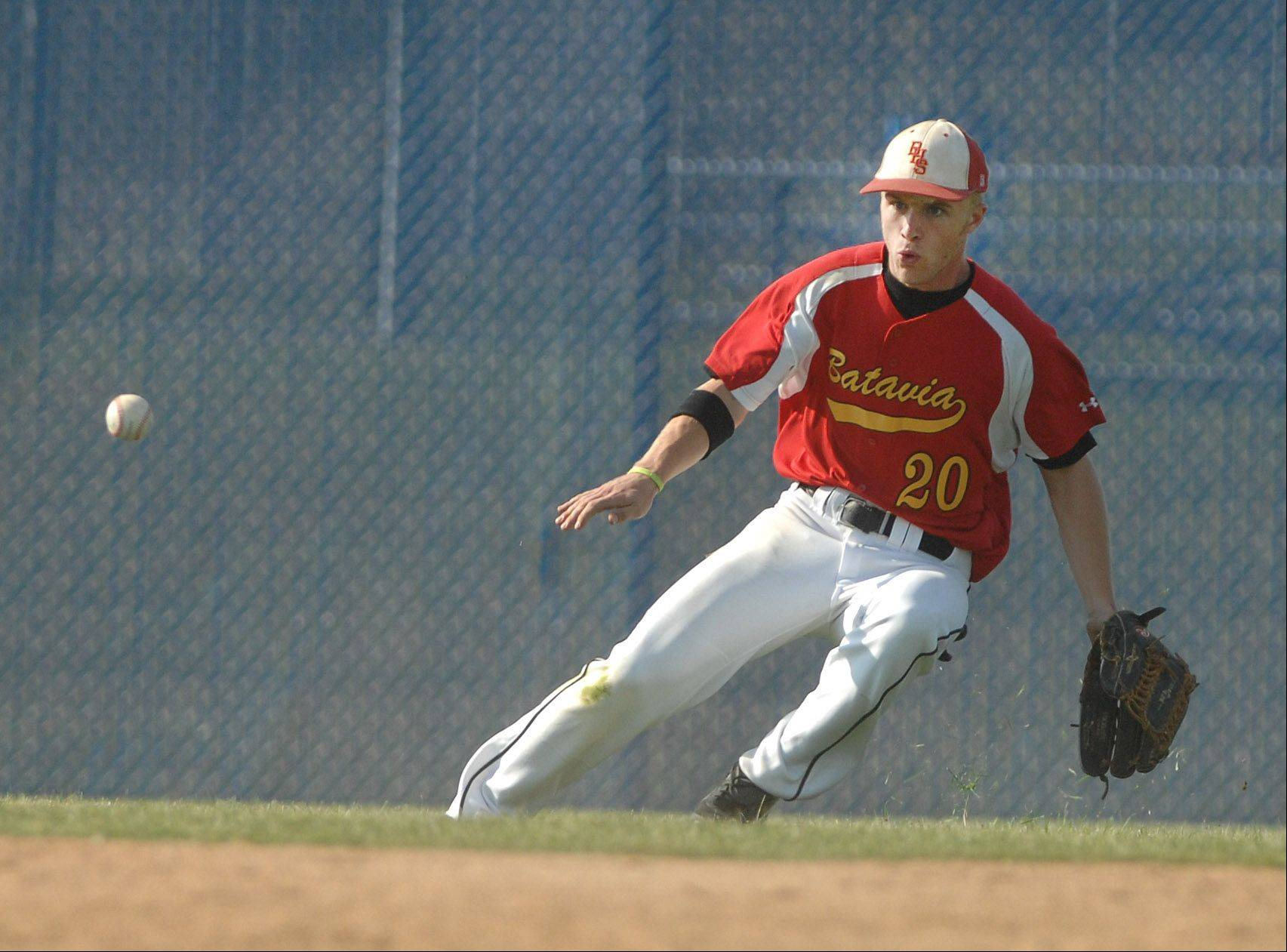 Sam Burnoski of Batavia keeps an eye on the ball during Thursday's baseball game against Addison Trail.