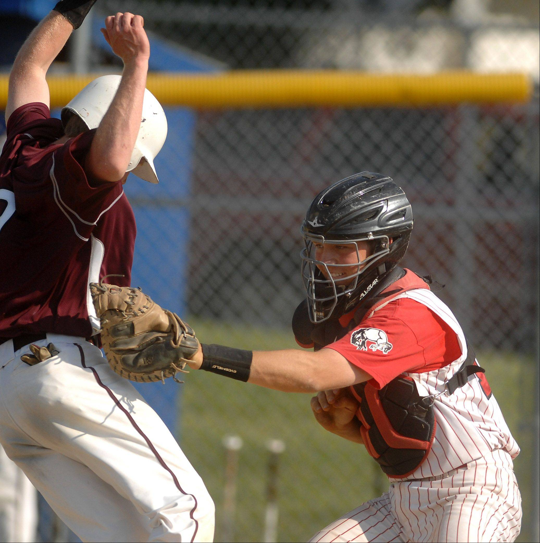 Barrington catcher Ryan Lidge tags out Elgin's Andrew Higdon at the plate during the regional semifinals at Larkin High School in Elgin Thursday.