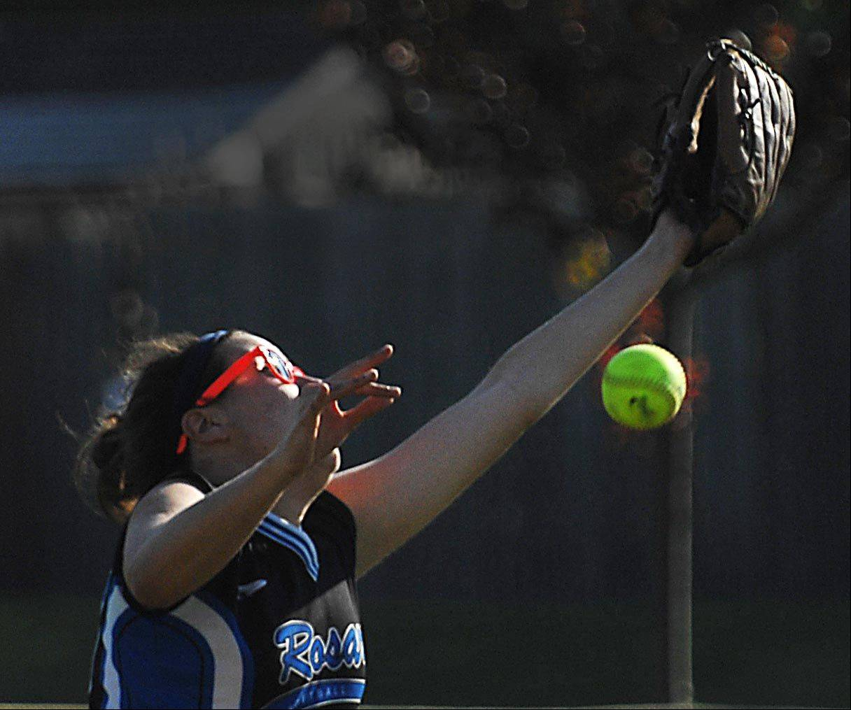Rosary's Maddie Hemmerich can't handle a fly ball by IMSA's Emerald Fikejs in Class 2A regional playoff game Monday in Aurora.