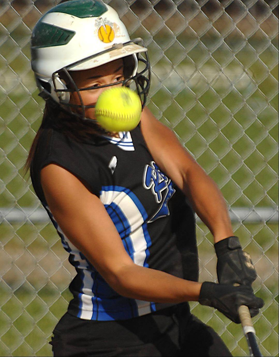 Rosary's Ariana Stone fouls a pitch over the backstop against IMSA in Class 2A regional playoff game Monday in Aurora.