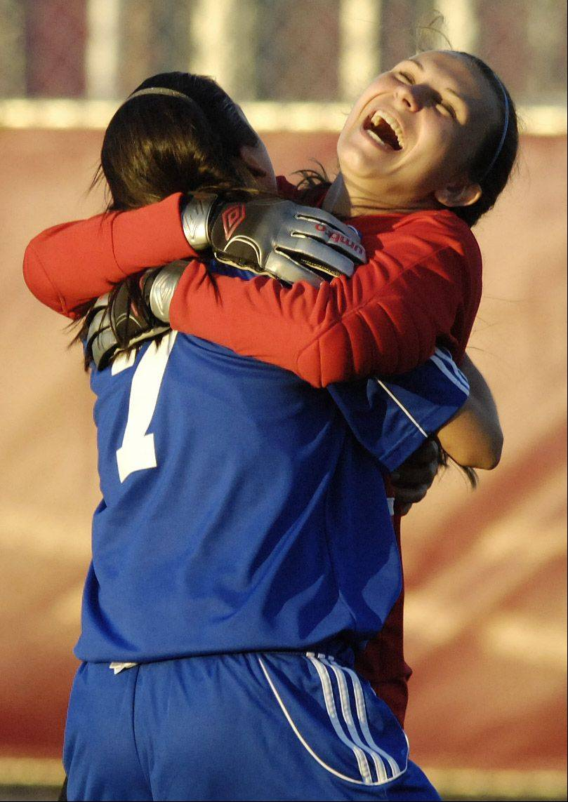 St. Charles North goal keeper Carly Dietrich, right, celebrates with teammate Ashlyn Walter after their team defeated Geneva 2-0 in Tuesday sectional semifinal.