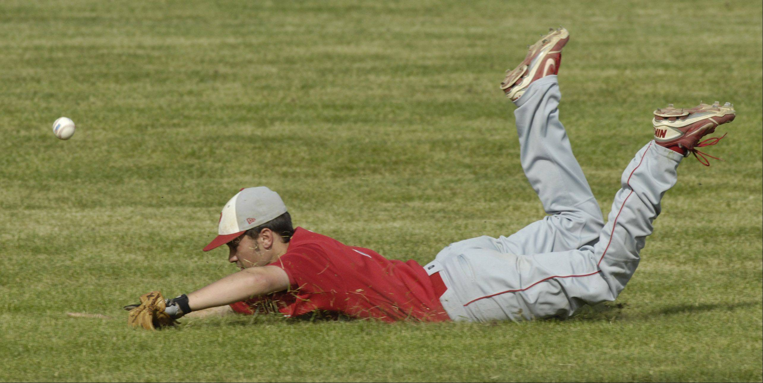 Palatine's Scott Schneberger makes a diving attempt for the ball during Wednesday's regional semifinal against Hersey.