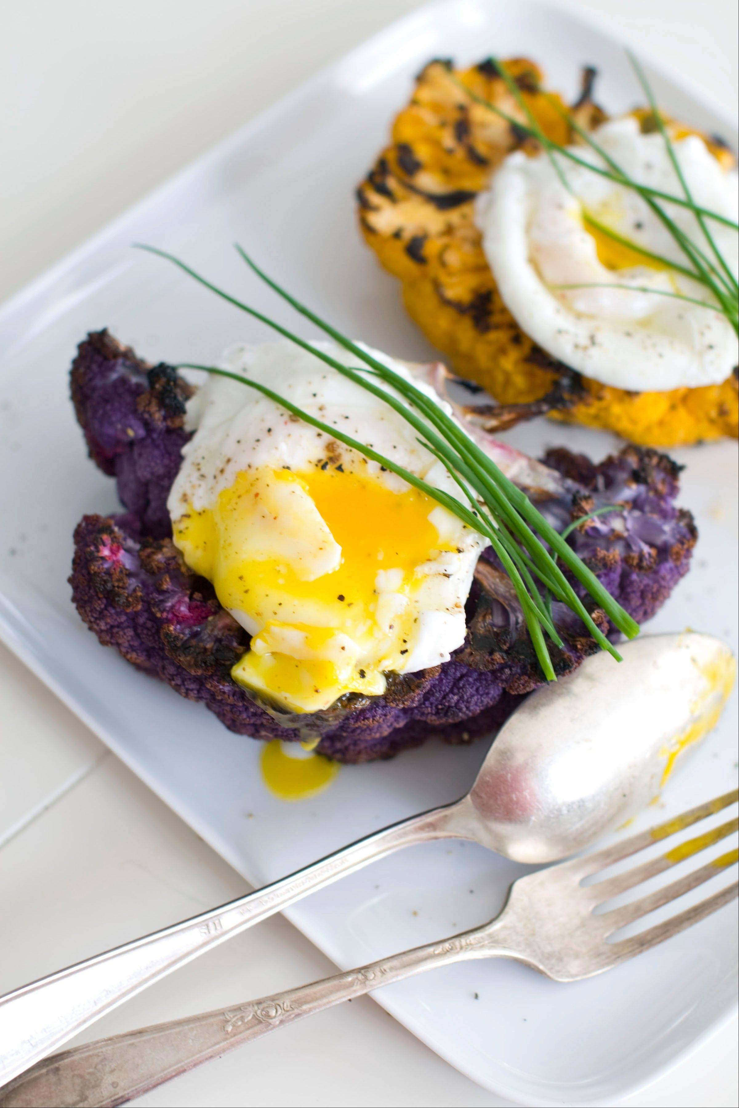 Purple cauliflower with poached eggs and truffle oil