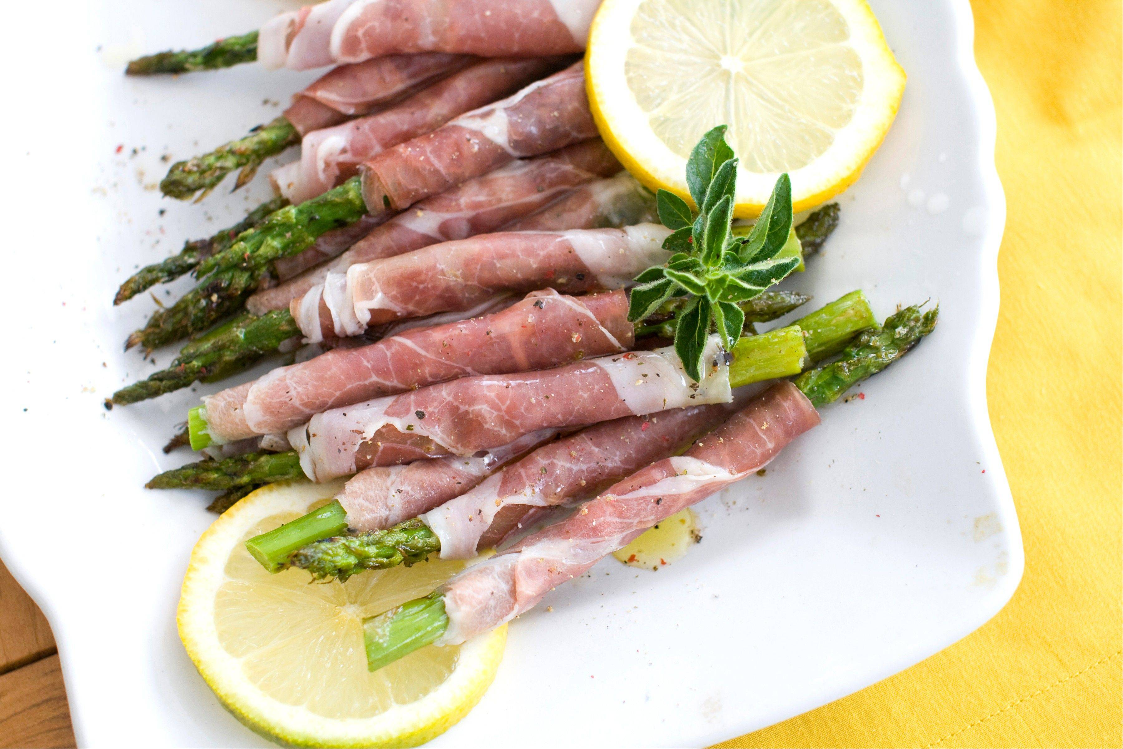 Prosciutto-wrapped grilled asparagus can be eaten on its own as an appetizer or added to a salad with fresh mozzarella.