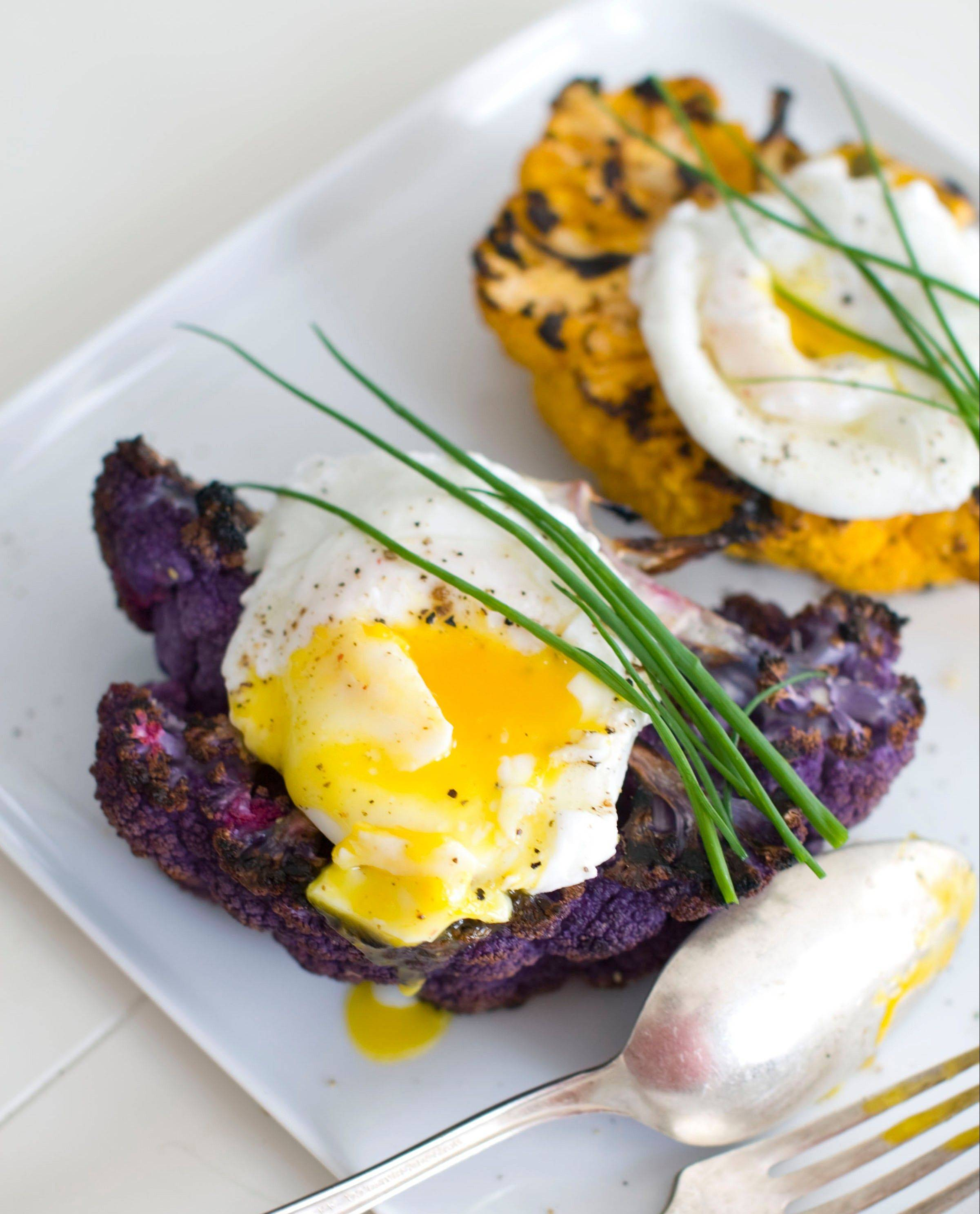 Grilled purple cauliflower stands in for steak in this brunch or dinner dish. The white version of this vegetable works just as well.