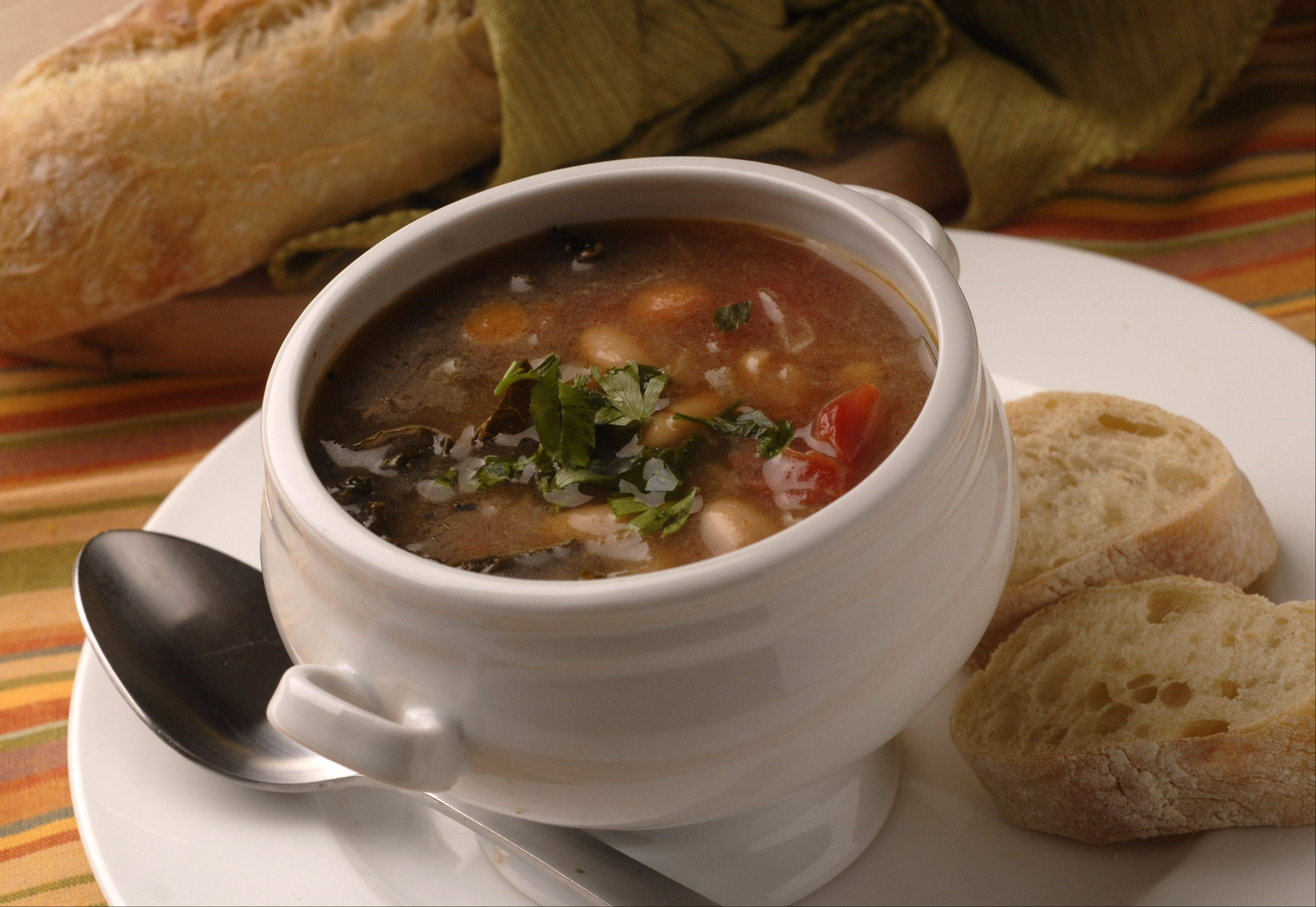 Kale stems and leaves add flavor and nutrients to Tuscan Bean Soup.