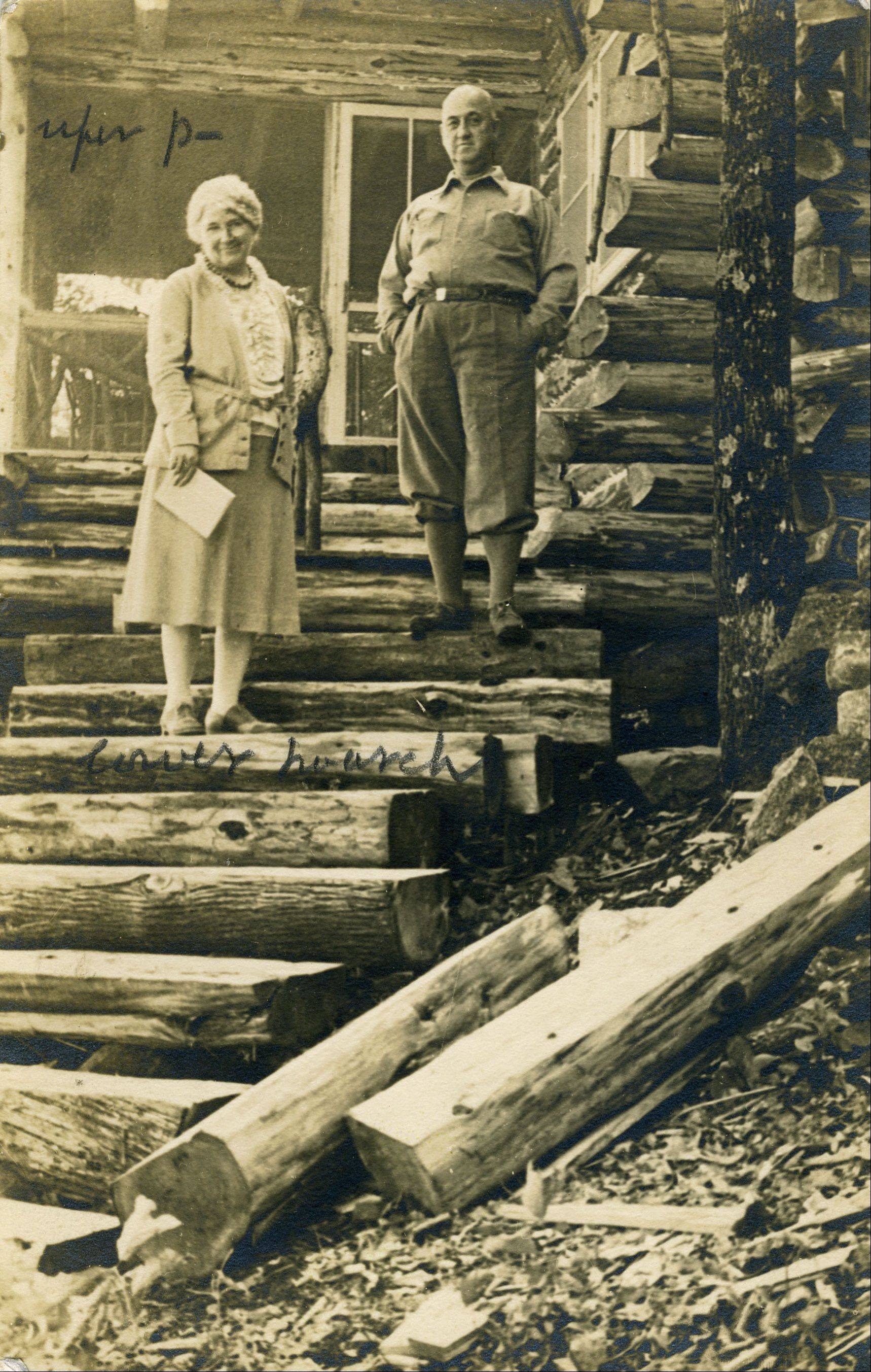 Marnie Mamminga's grandparents pose on their newly constructed log steps at Wake Robin, 1929.
